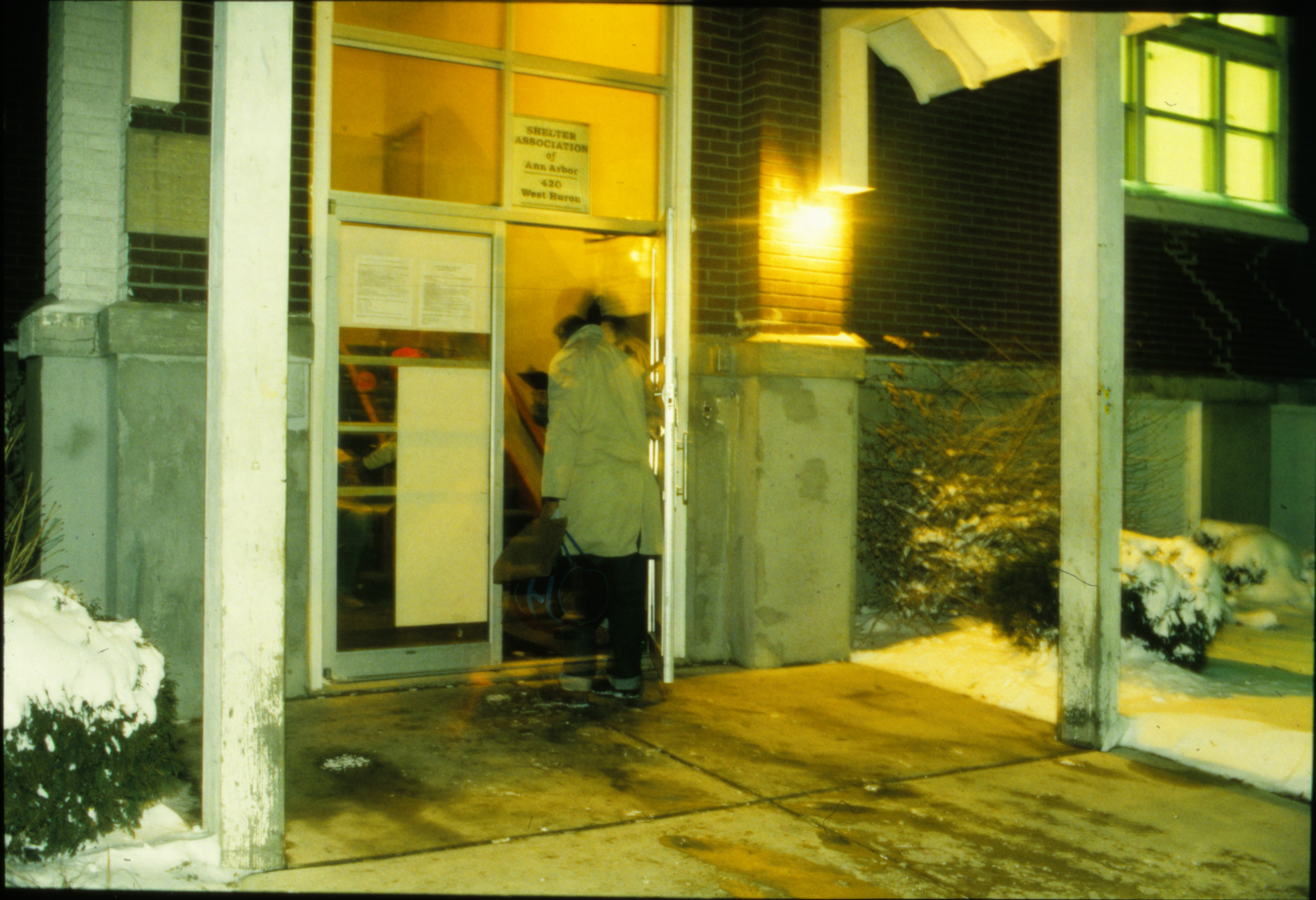 Don Godell Lets in Overnight Guests at Ann Arbor Homeless Shelter, January 1992 image