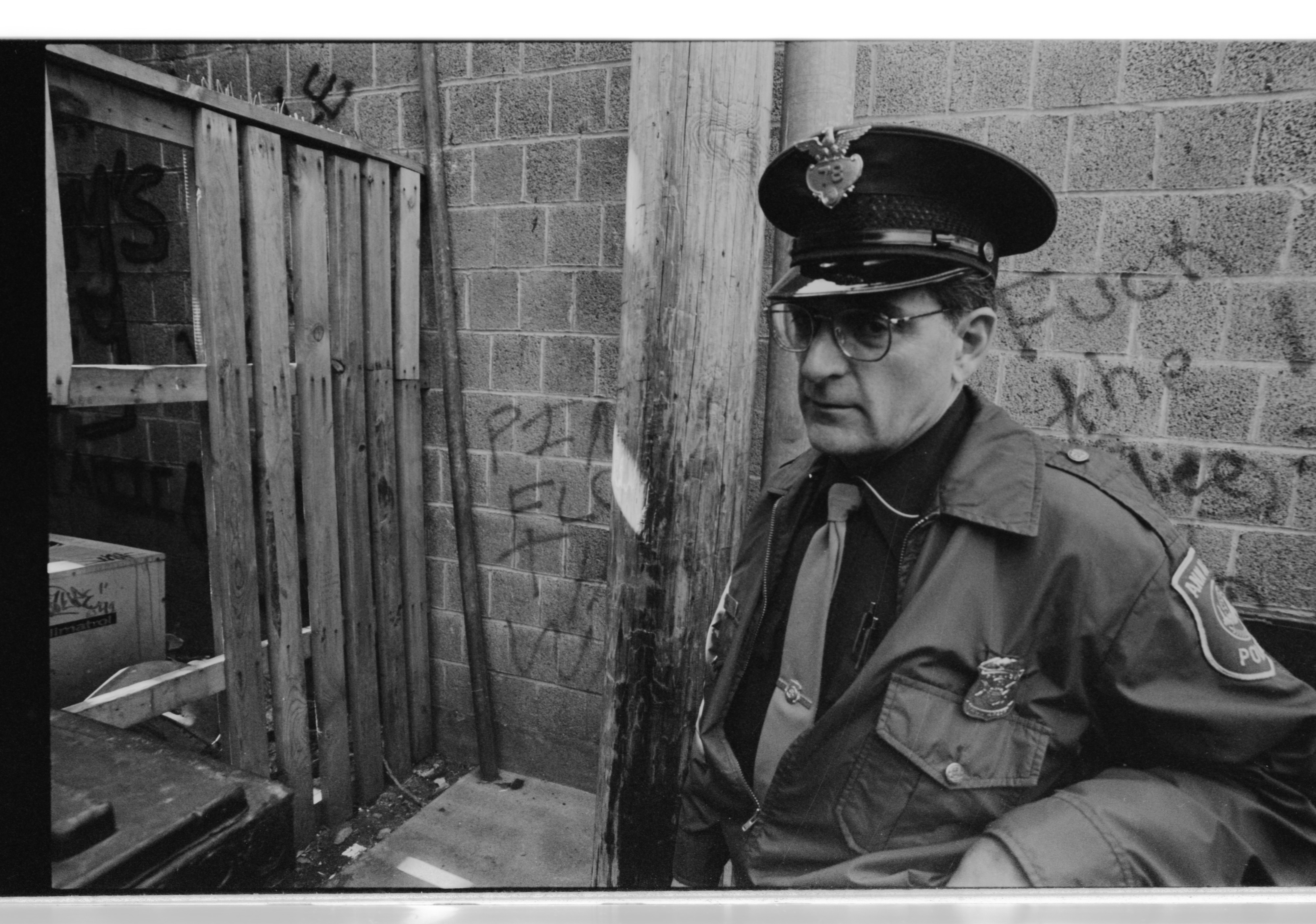 Downtown Ann Arbor Beat Cop Phil LaVigne Checks Out An Alley, October 1991 image