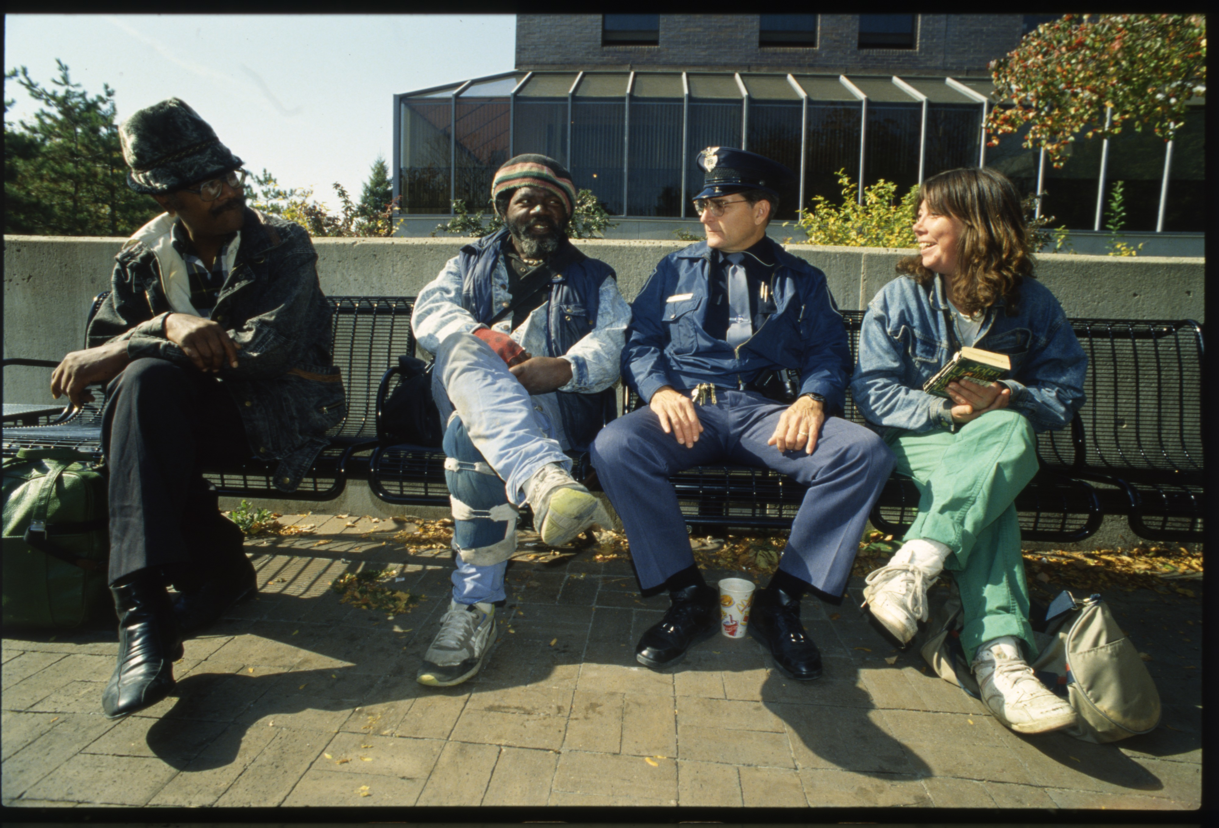 Downtown Ann Arbor Beat Cop Phil LaVigne Chats With Liberty Square Regulars, October 1991 image