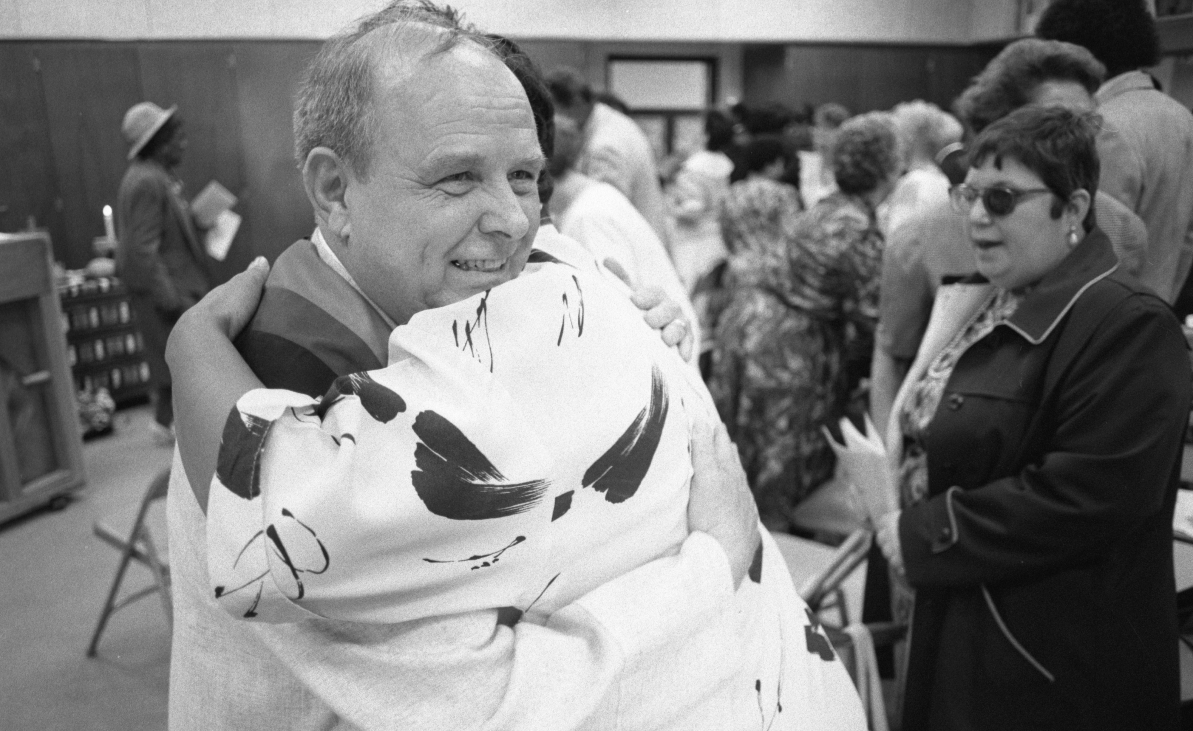 Rev. Herbert Lowe Hugs A Congregant At The First Service Of Amistad Community Church, May 1991 image