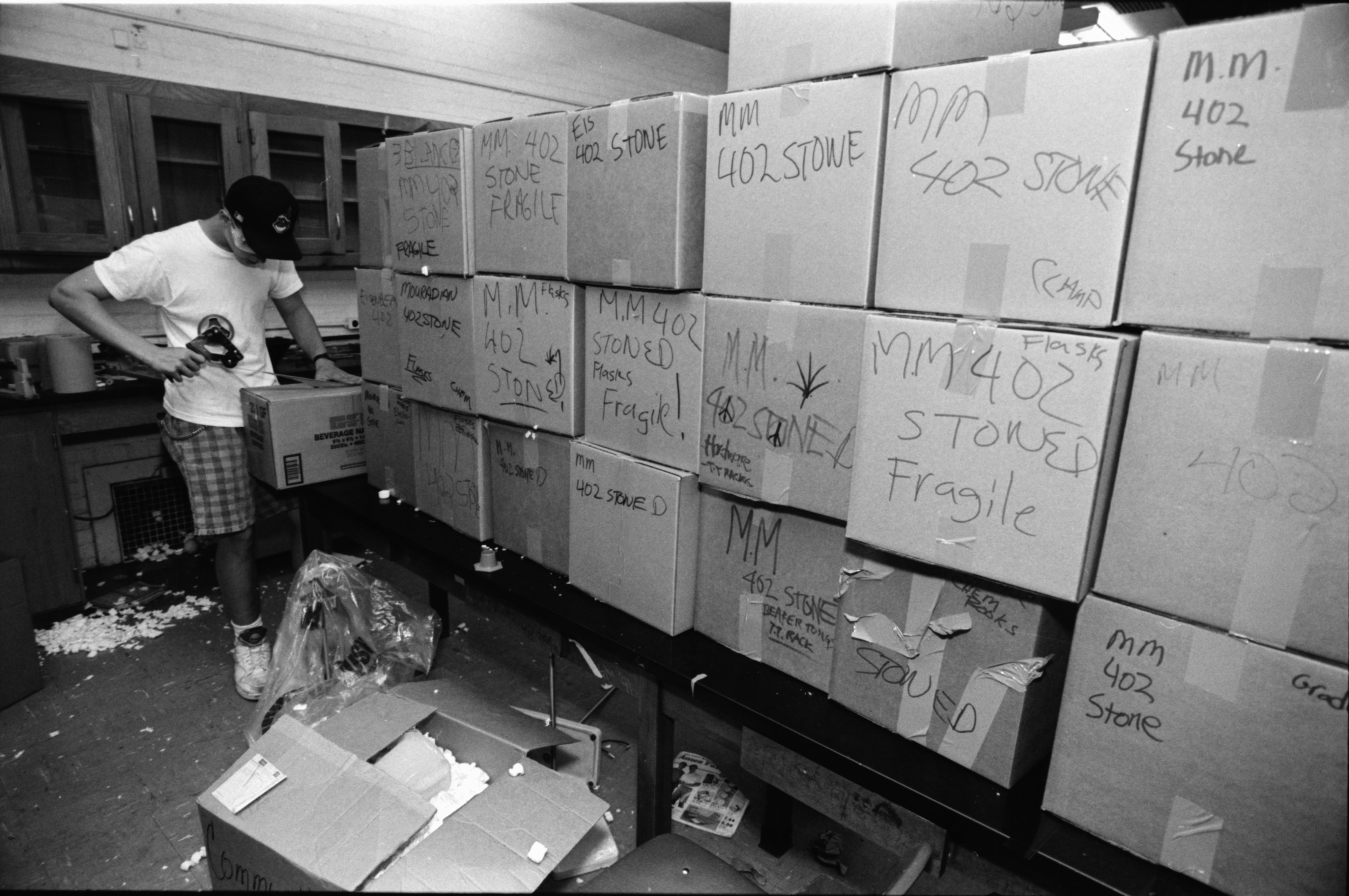 Aaron Almashy Tapes Boxes to Move to Stone School During Community High Renovations, June 1991 image