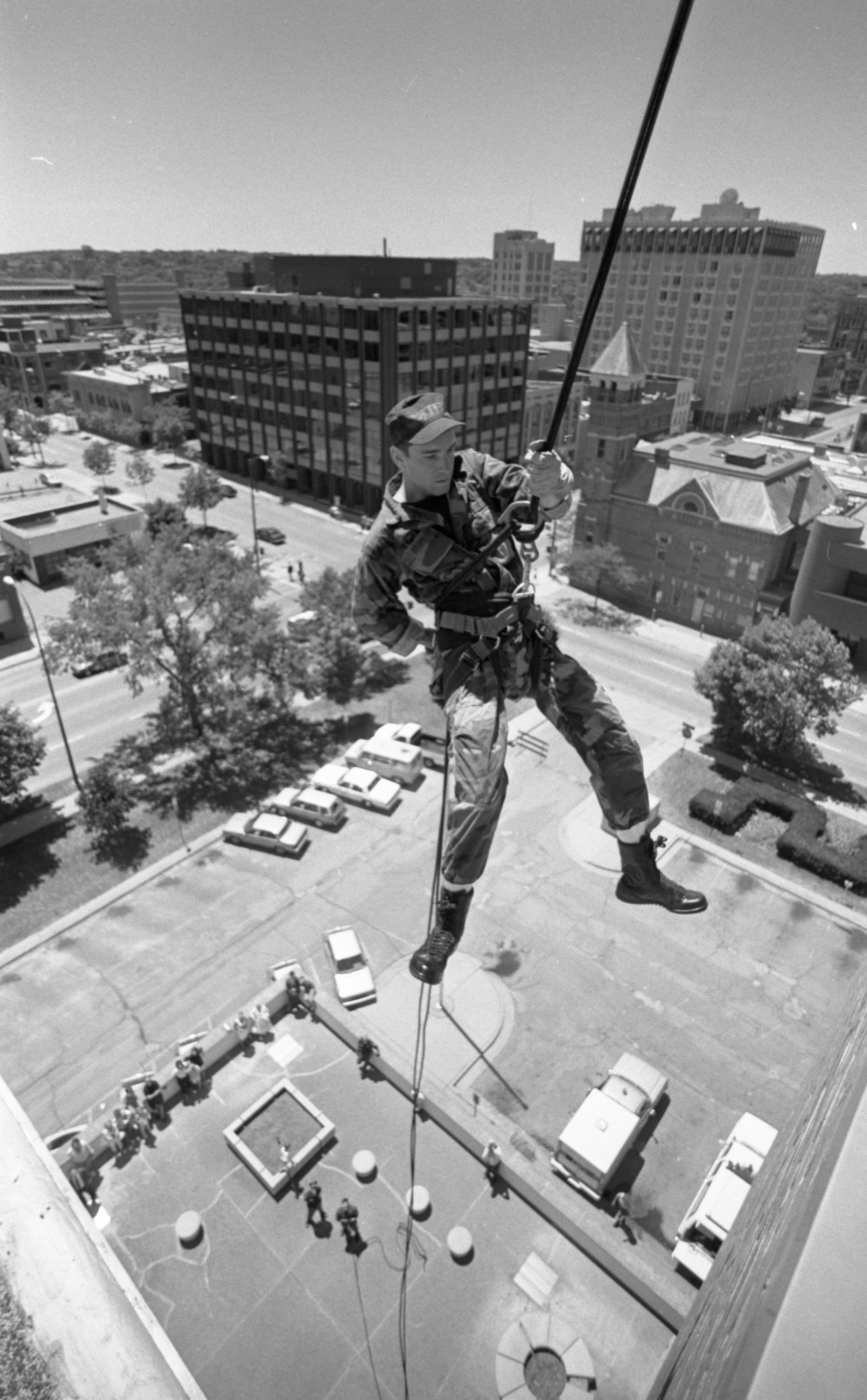 Officer Peter Stipe, AAPD Special Tactics Unit, Demonstrates Rappelling From The Top Of City Hall, June 1991 image