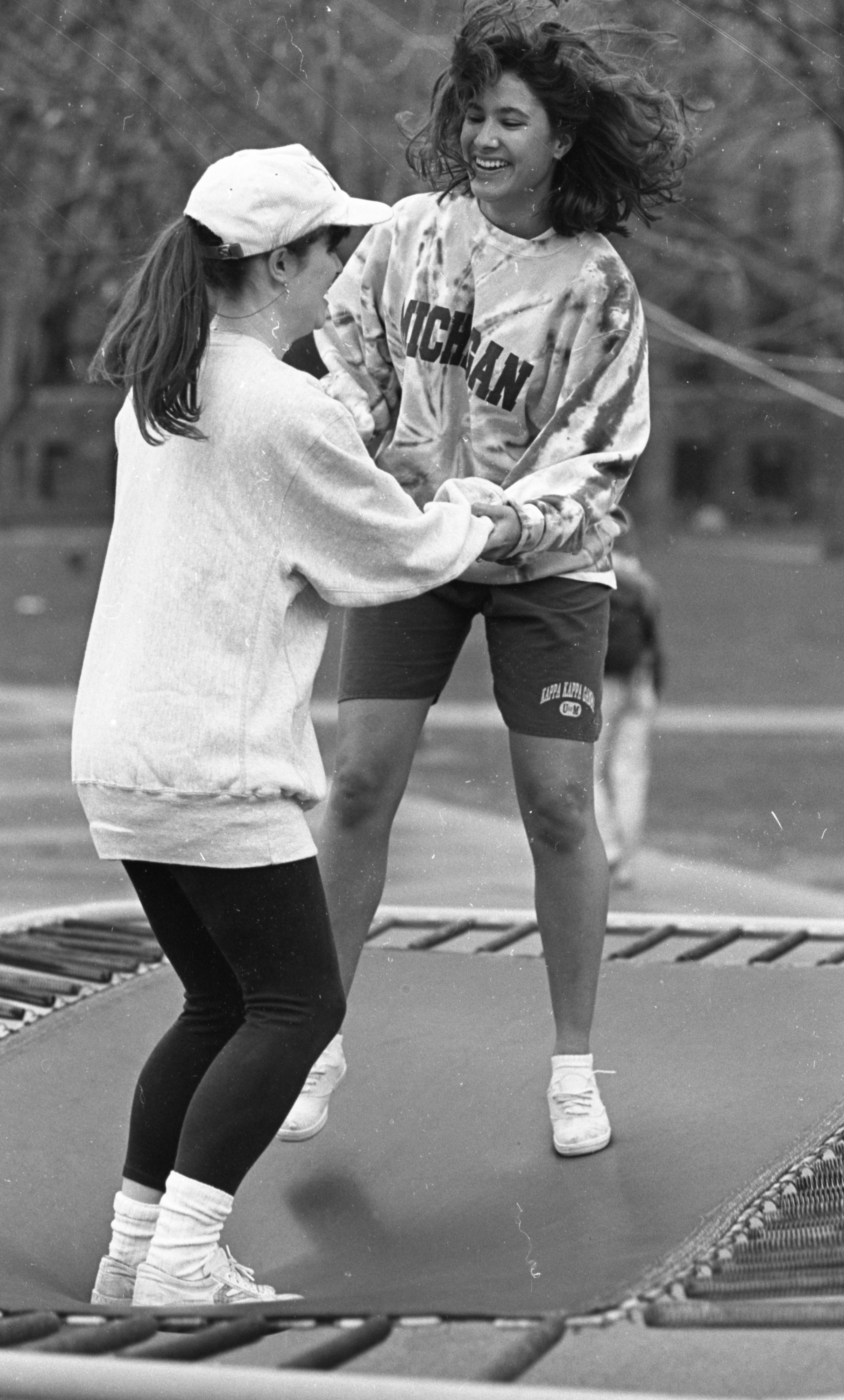Christie Meyer & Vickie Bansell Jump In A Trampoline-A-Thon On The Diag, April 1991 image