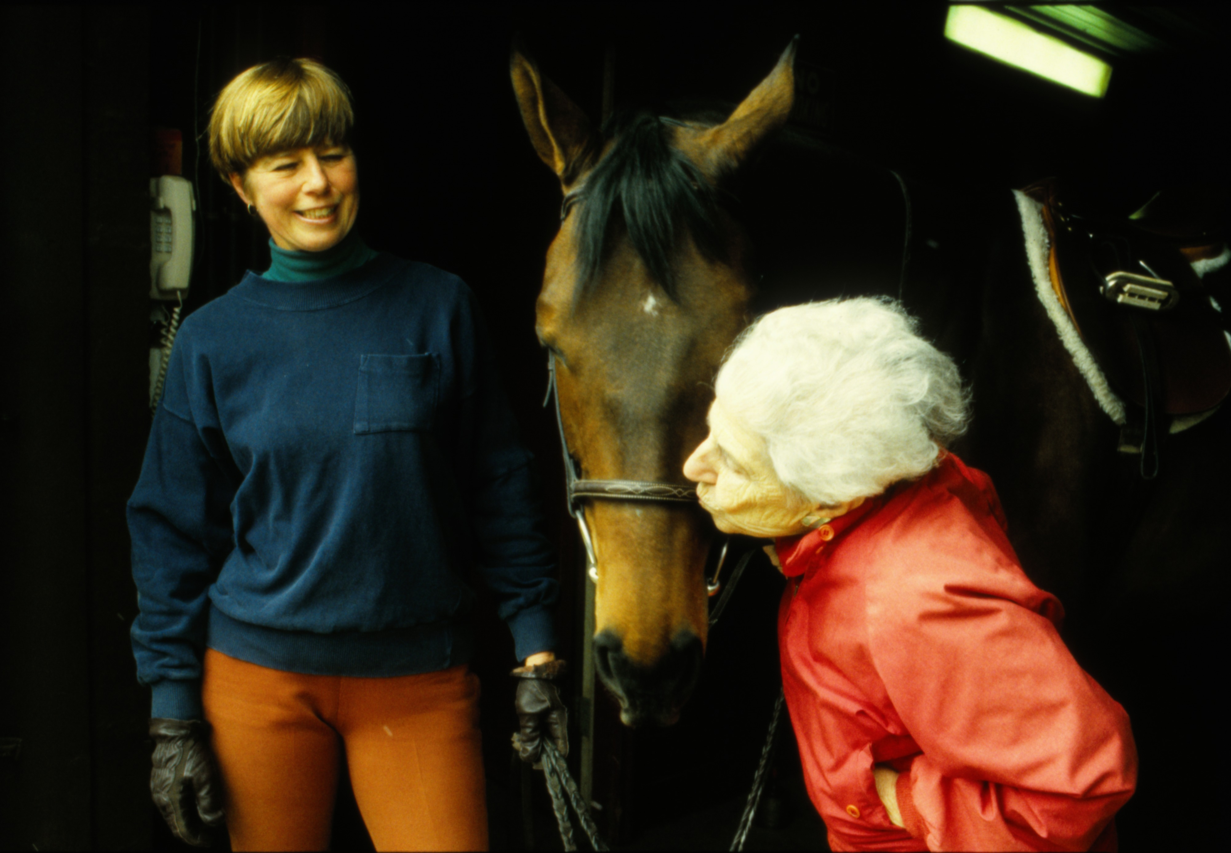 Cindy Carlson watches Ruth Everett give thoroughbred Elegant Jade a kiss, April 1991 image