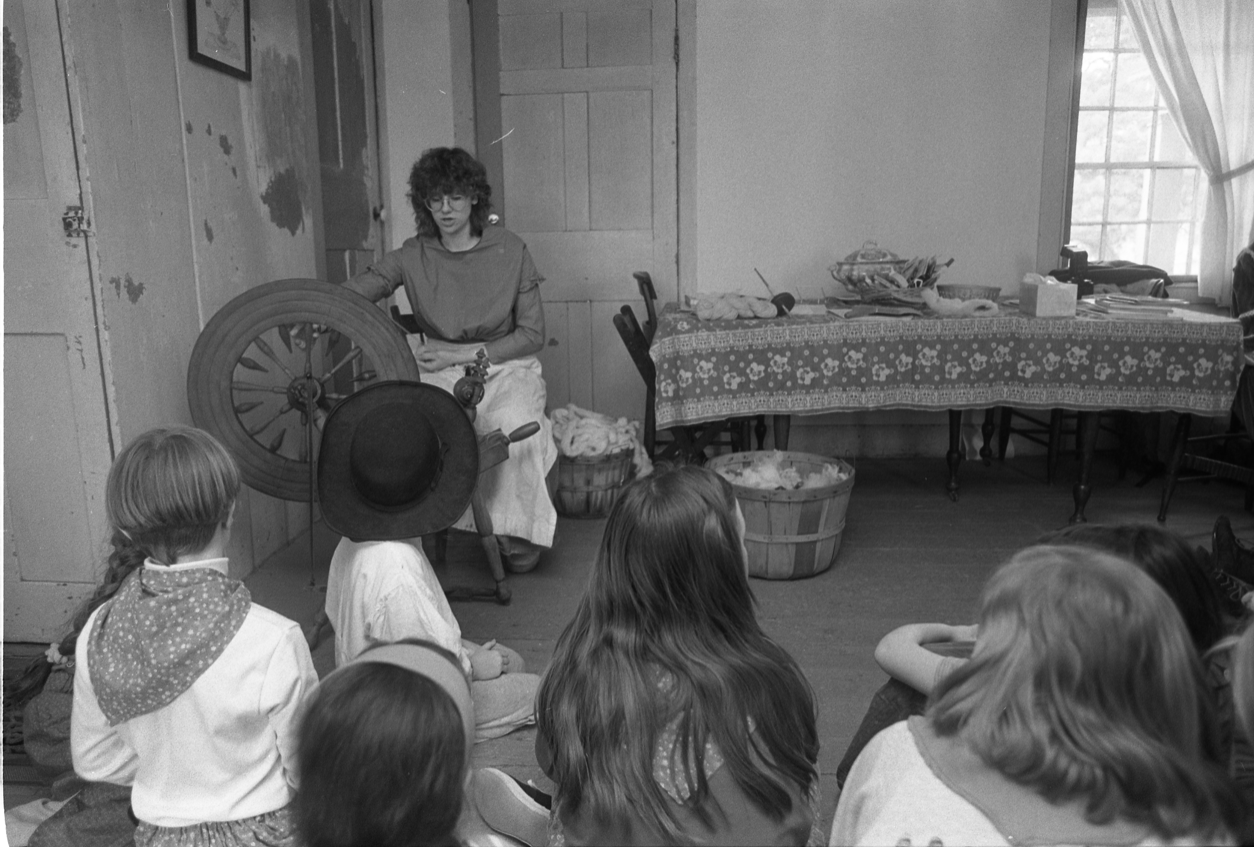 Children Learn About Spinning Wool At Pioneer Living Day Camp At Cobblestone Farm, April 1992 image