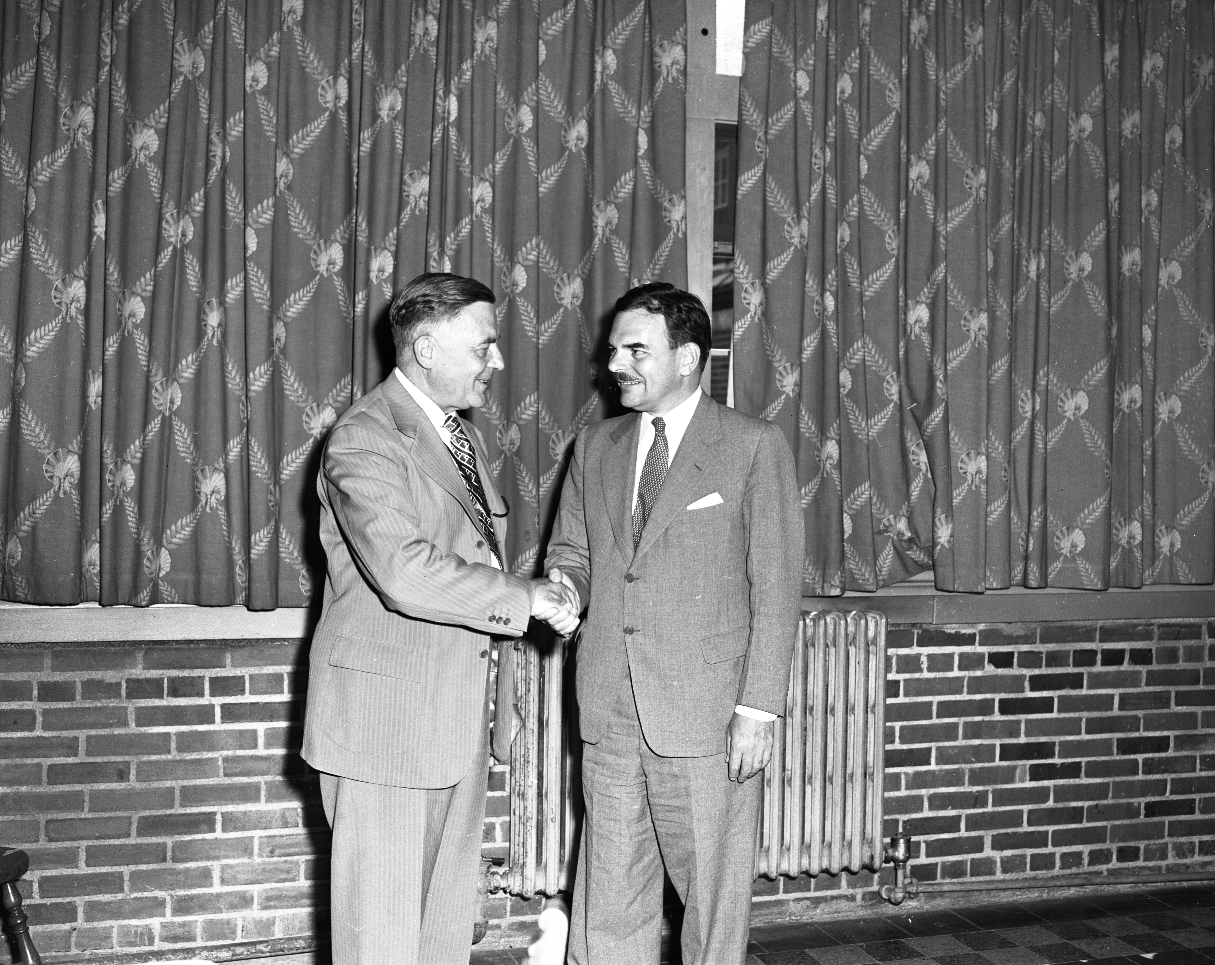 Gov. Thomas E. Dewey Greeted By University of Michigan President Alexander G. Ruthven, July 1947 image