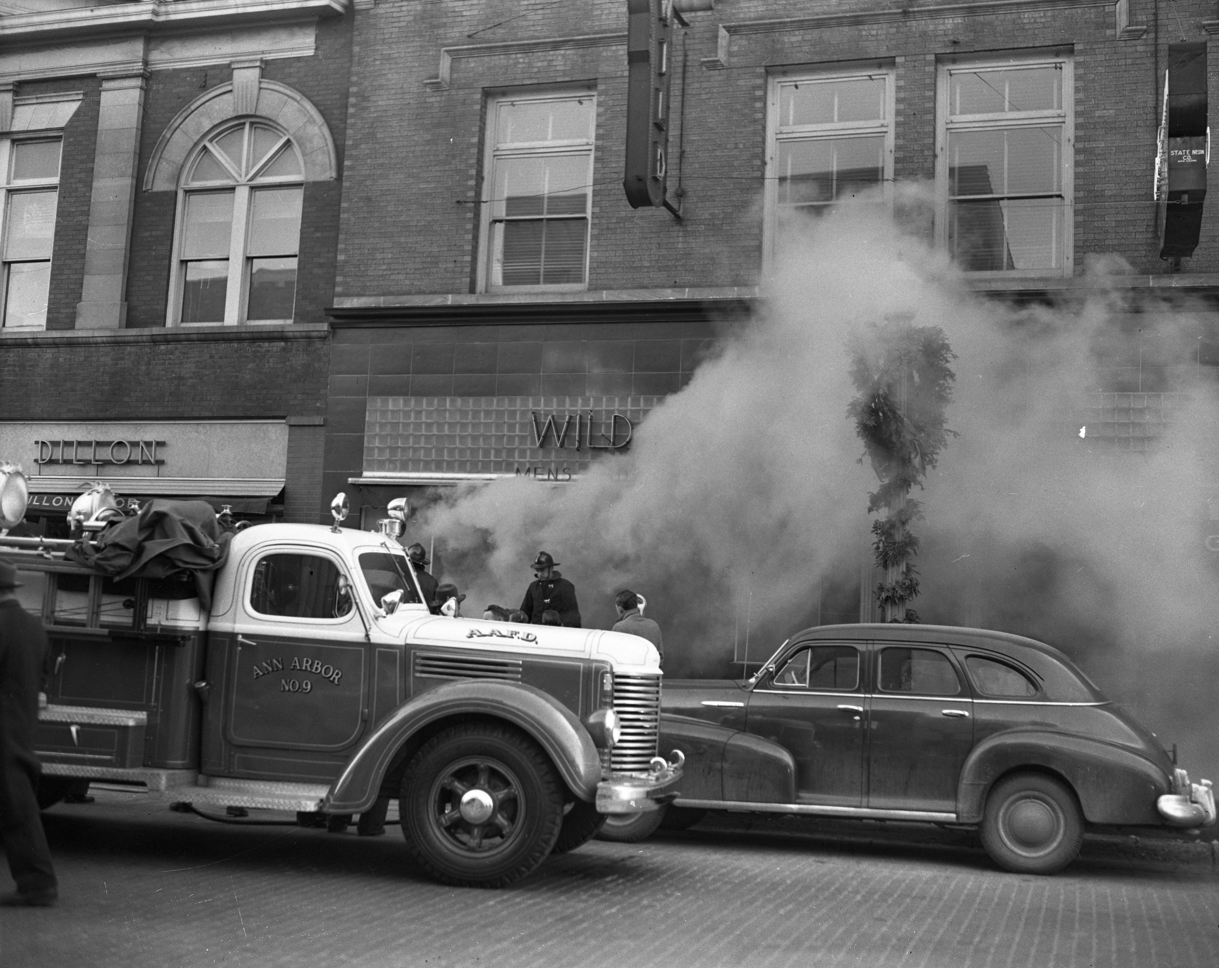 Ann Arbor Fire Truck Battles Wild & Co. Fire On State St, December 1947 image