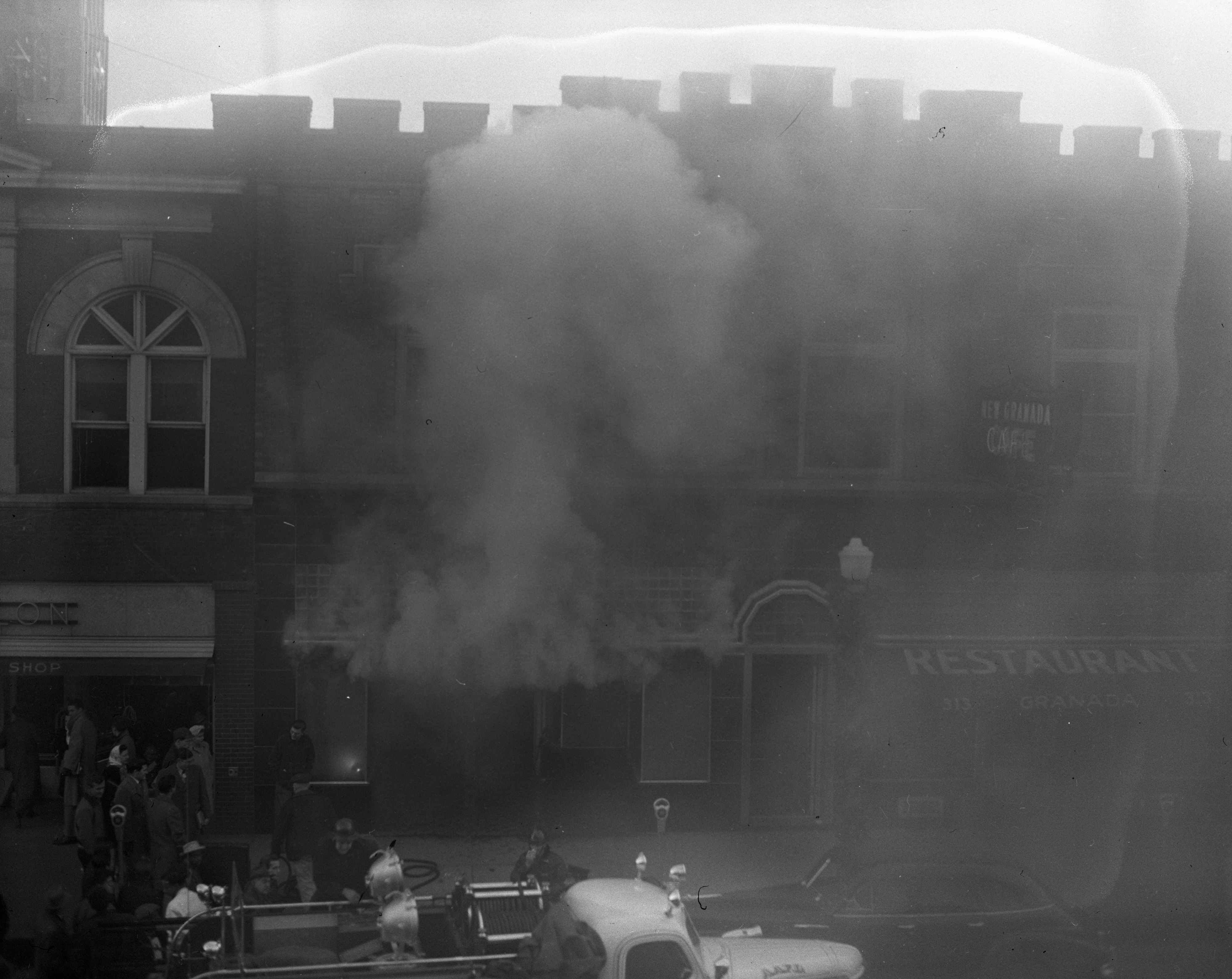 Adjoining Businesses Engulfed in Smoke During Wild & Co. Fire On State St, December 1947 image