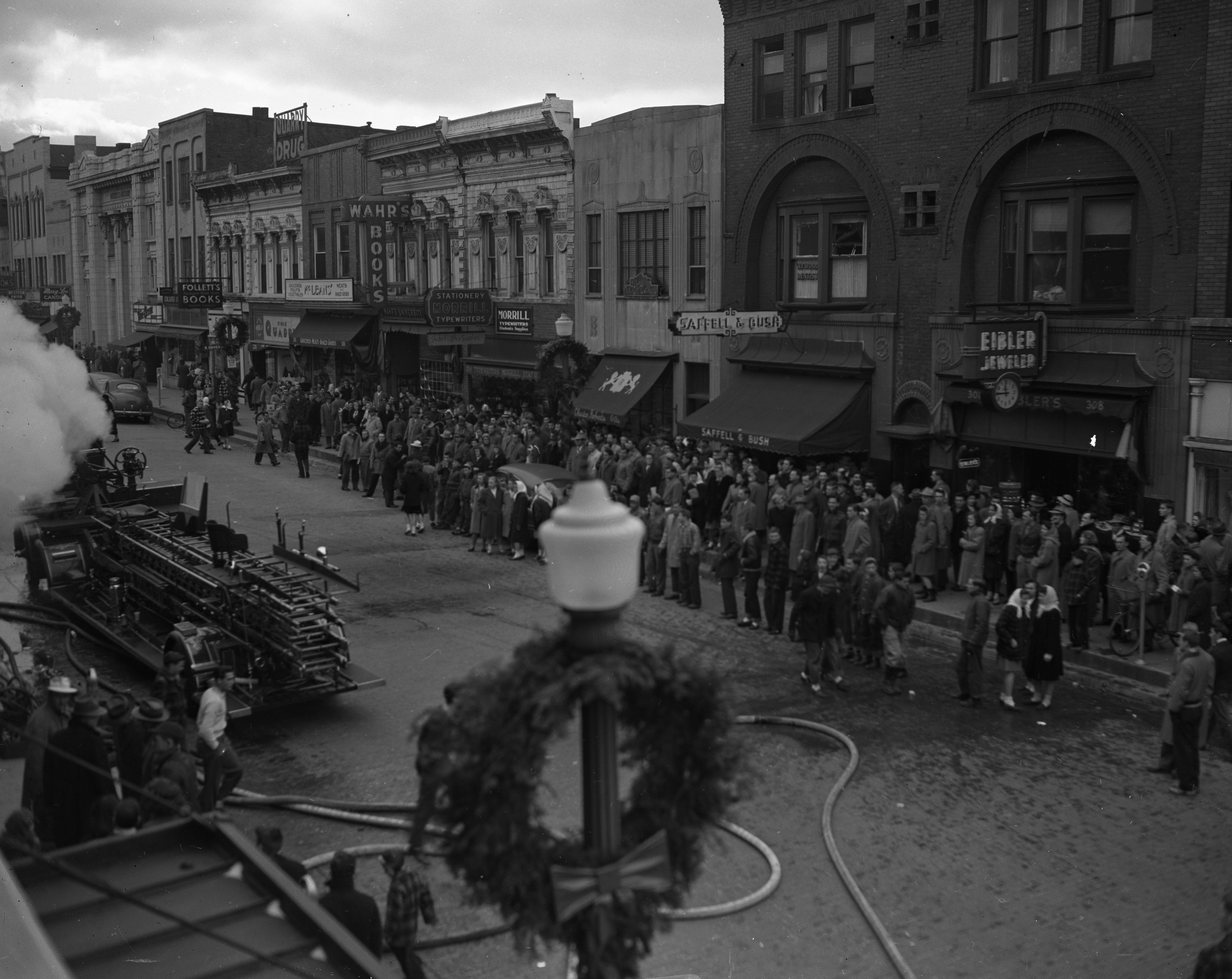 Crowds Assemble On State St To Watch Ann Arbor Fire Department Battle Wild & Co. Fire, December 1947 image