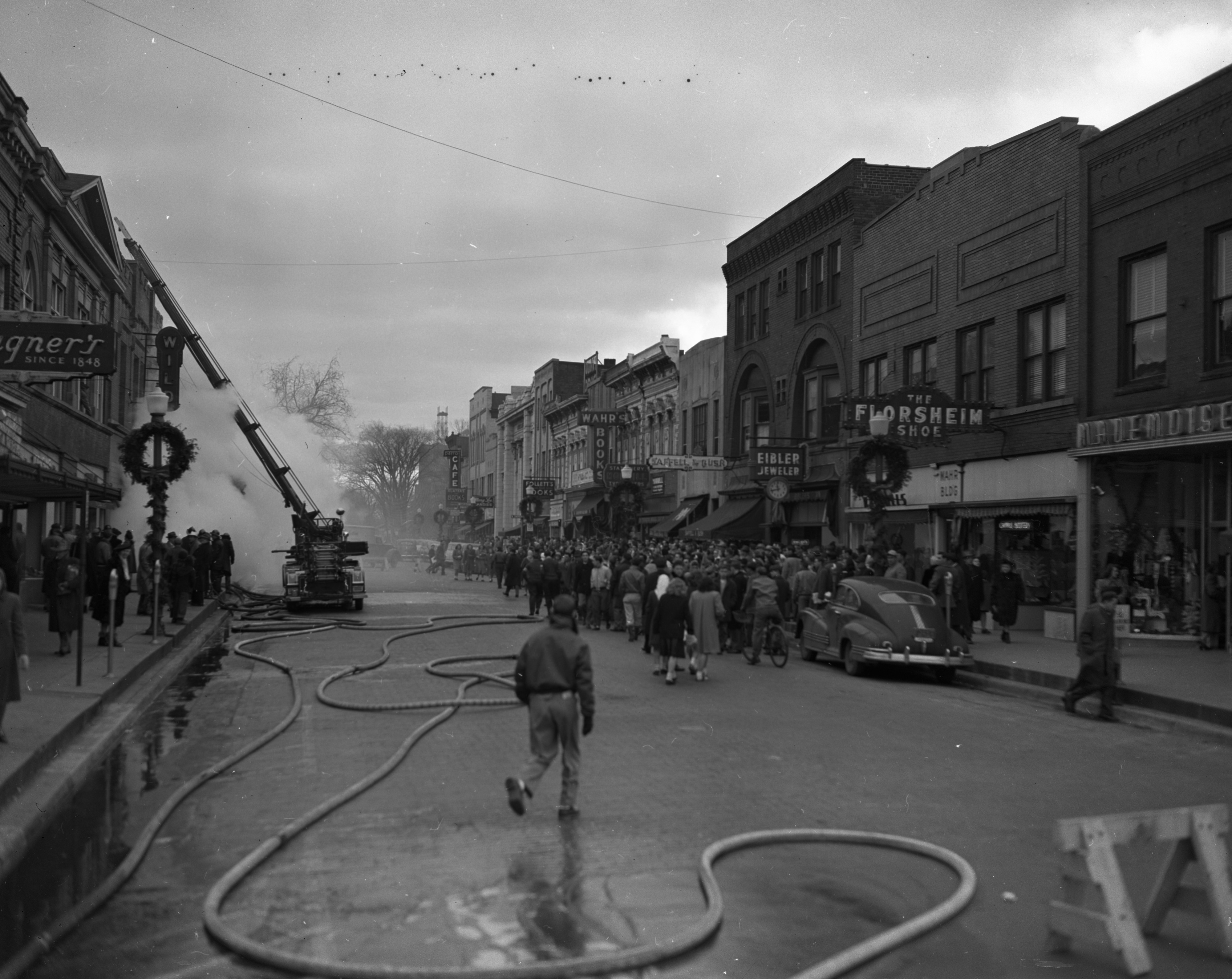 Students and Townies On State St Watch Ann Arbor Fire Department Battle Wild & Co. Fire, December 1947 image