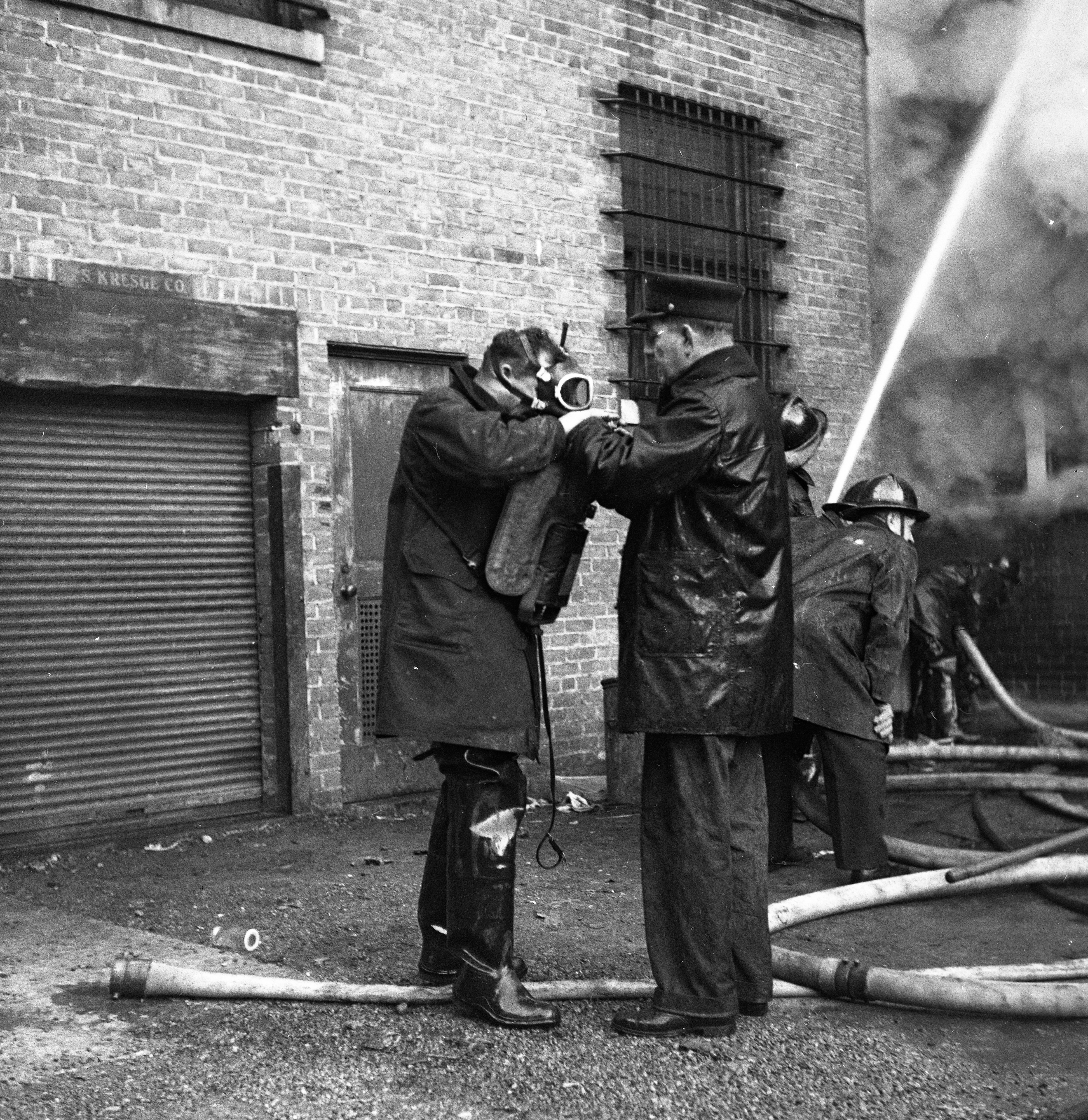 Ann Arbor Fire Department Dons Protective Gear In Battling Wild & Co. Fire On State St, December 1947 image