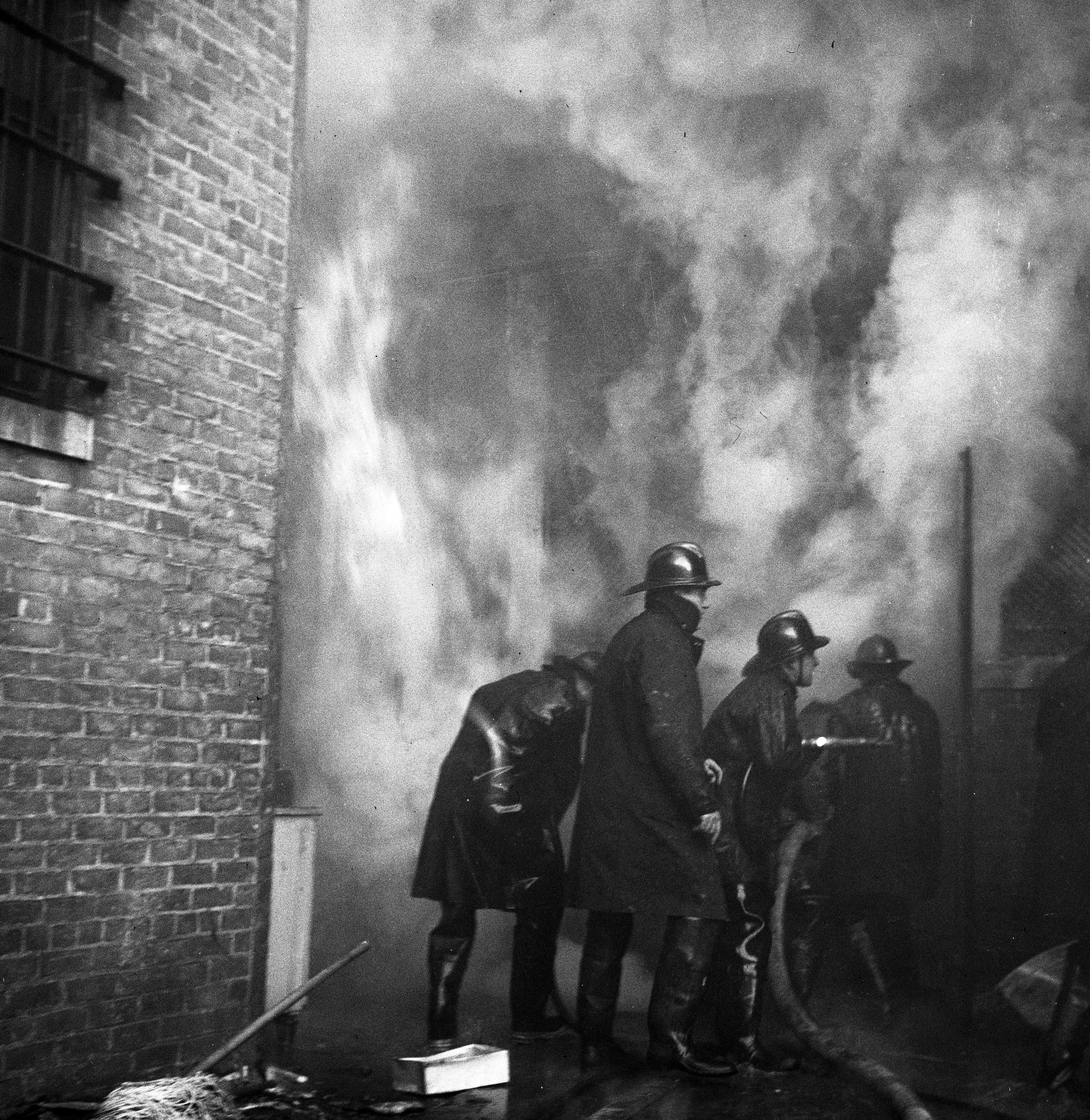Flames Shoot Out of Rear of Wild Building During Wild & Co. Fire, December 1947 image