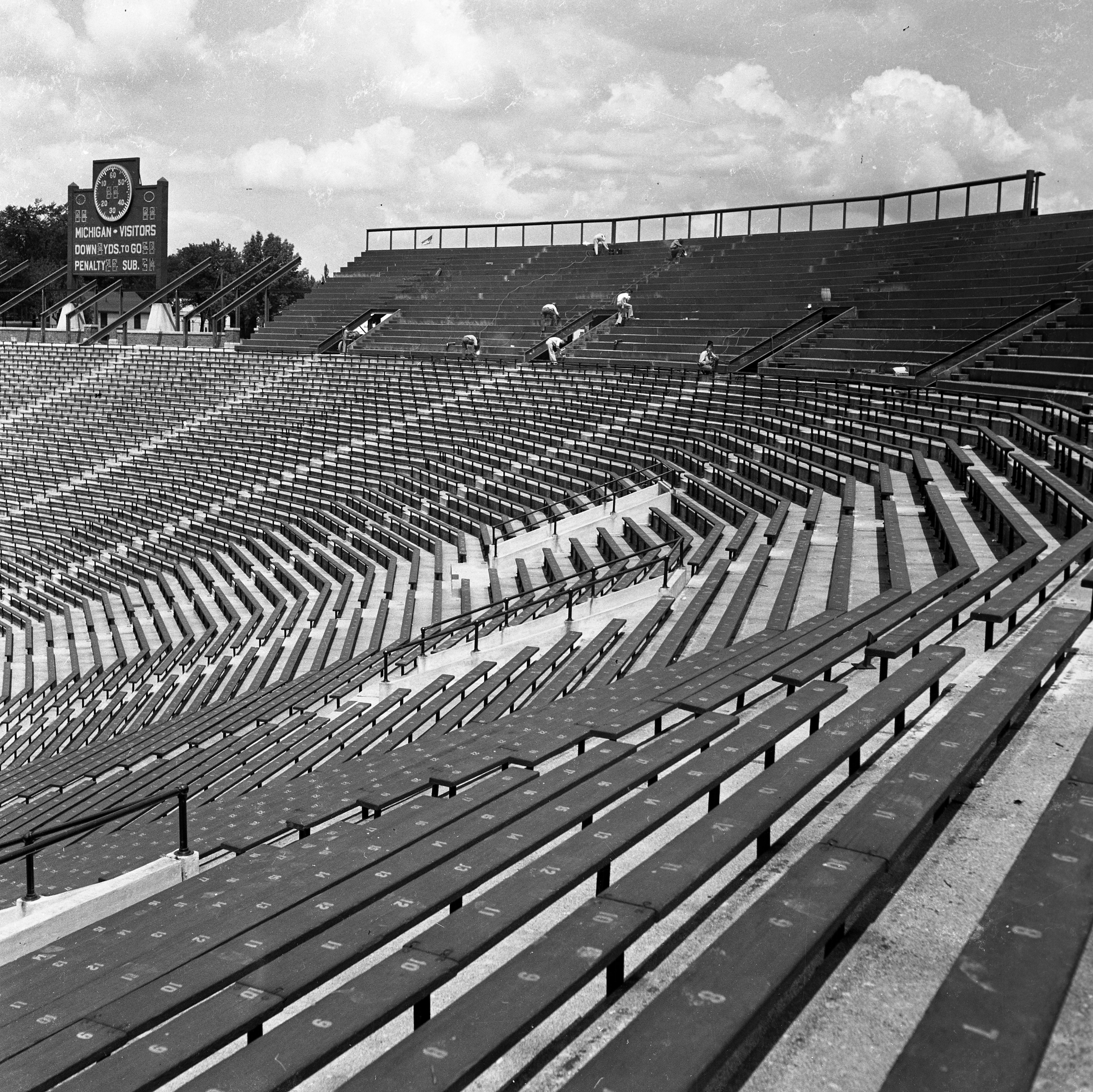 Building extra seats in the University of Michigan Stadium, 1949 image