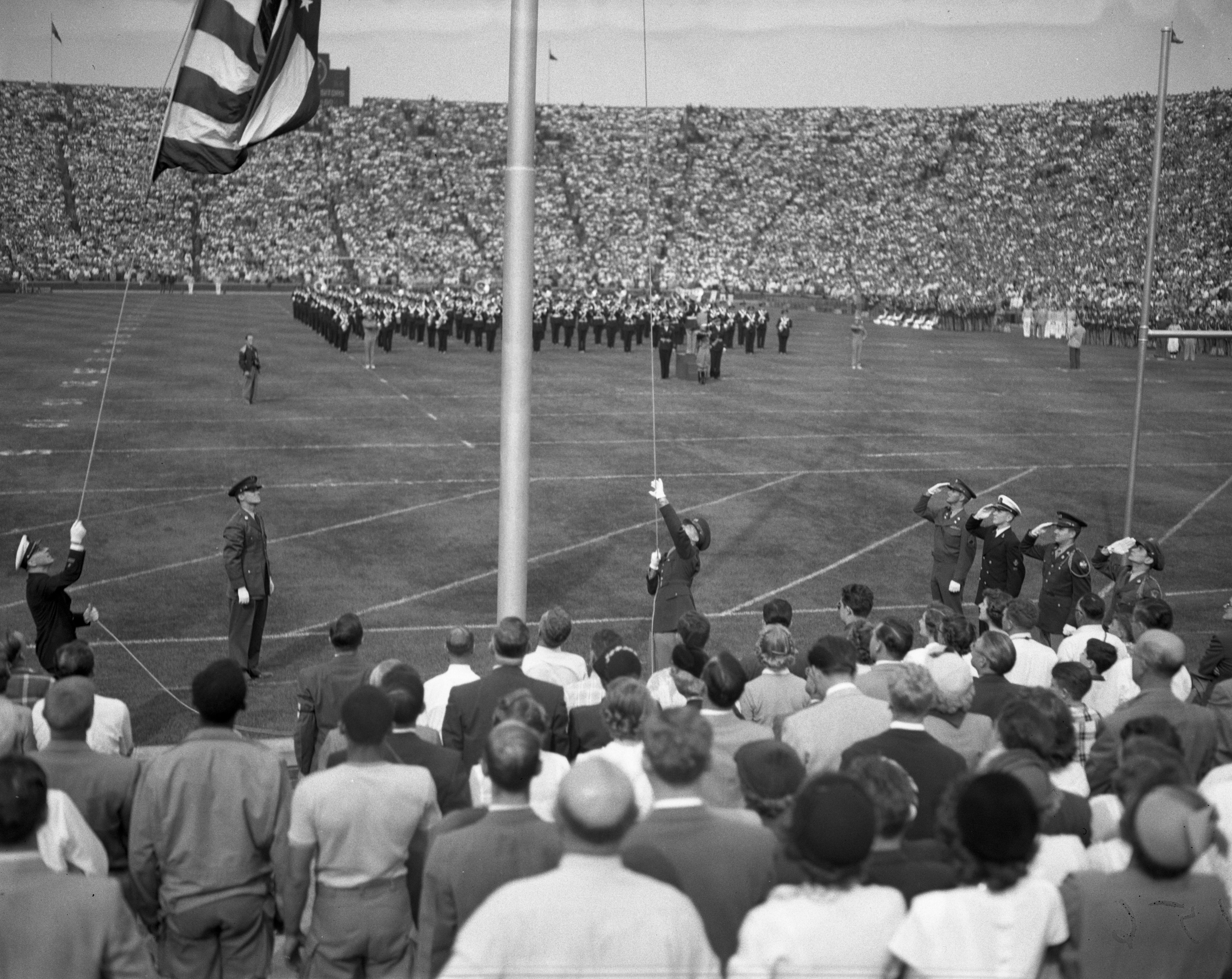 Raising the Flag at Football Game, 1950 image