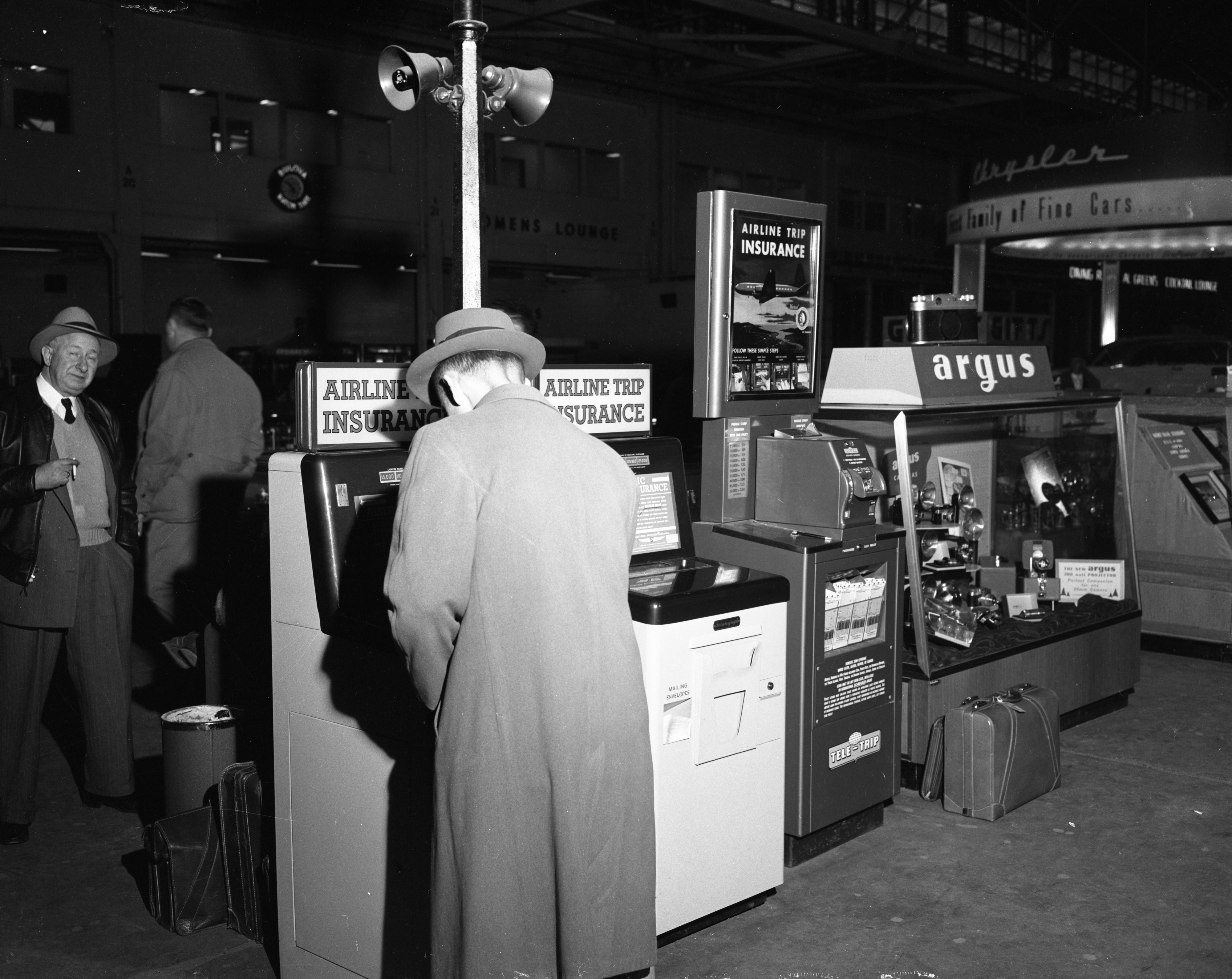 Travel Insurance Kiosk at Willow Run Airport, February 1954 image