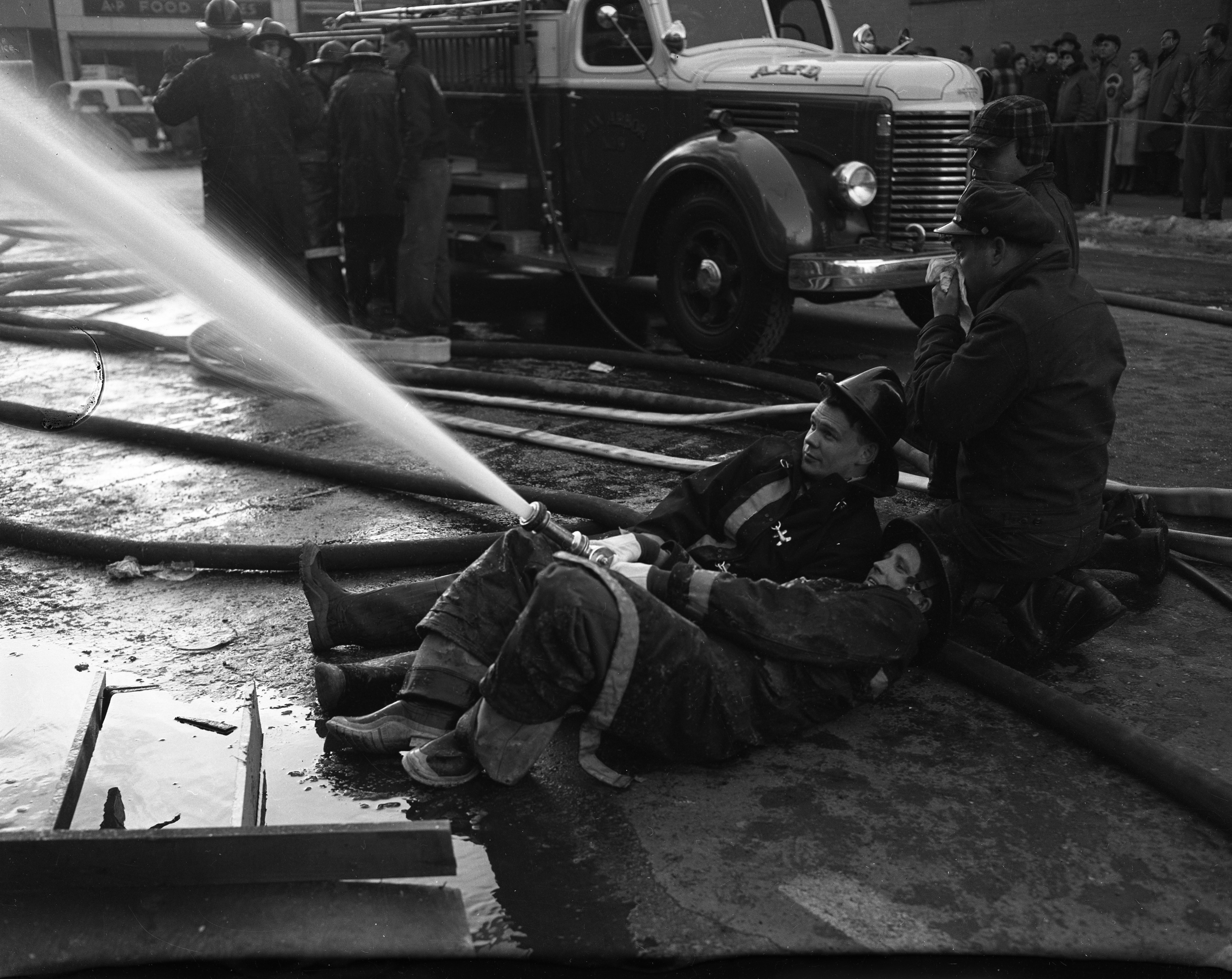 Ann Arbor Firemen Train Hoses on Massive Fire at Campus Drug Store Building, February 1954 image