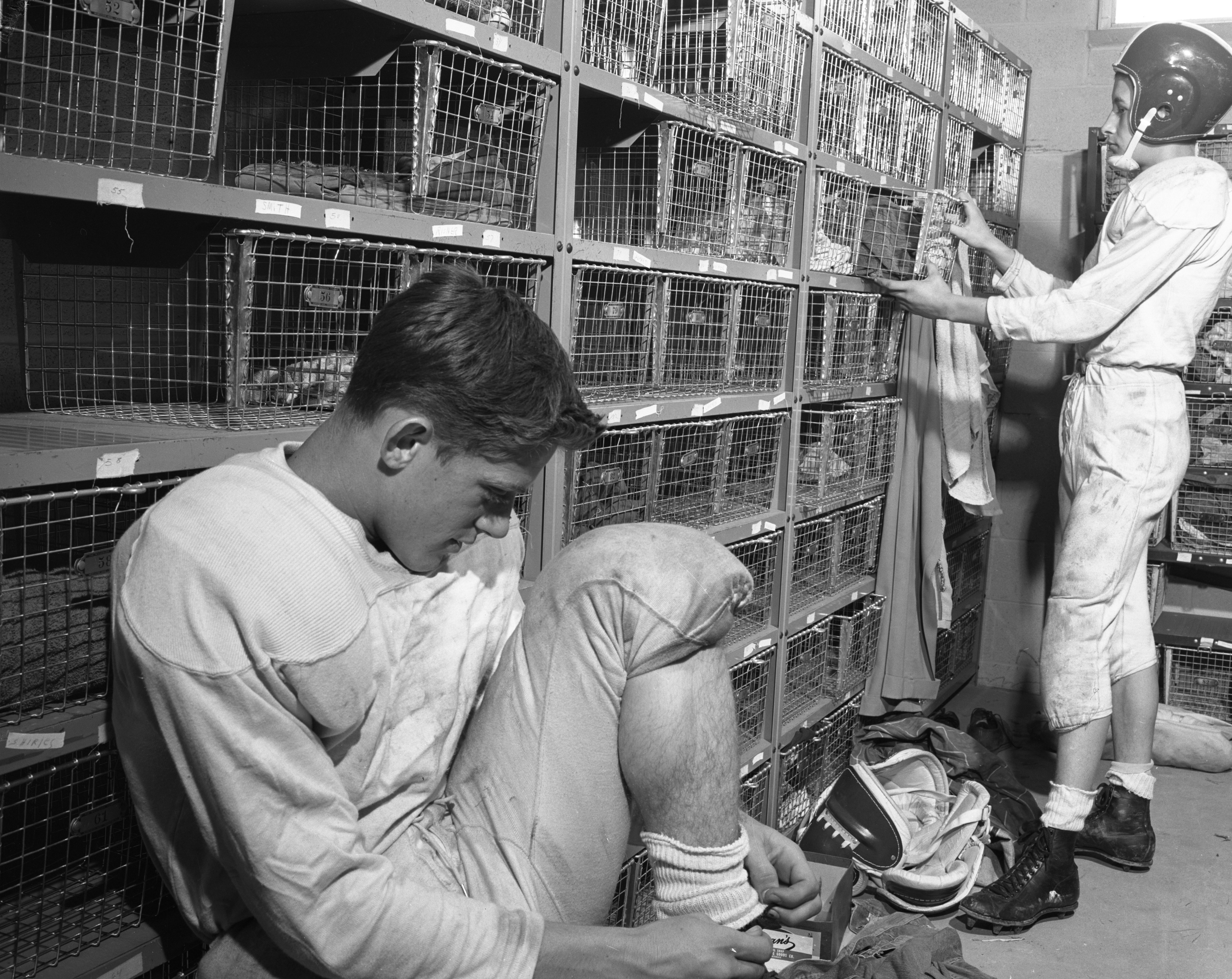 Jim Alexander and Dan Foster use baskets for lockers at Willow Run High, September 1954 image