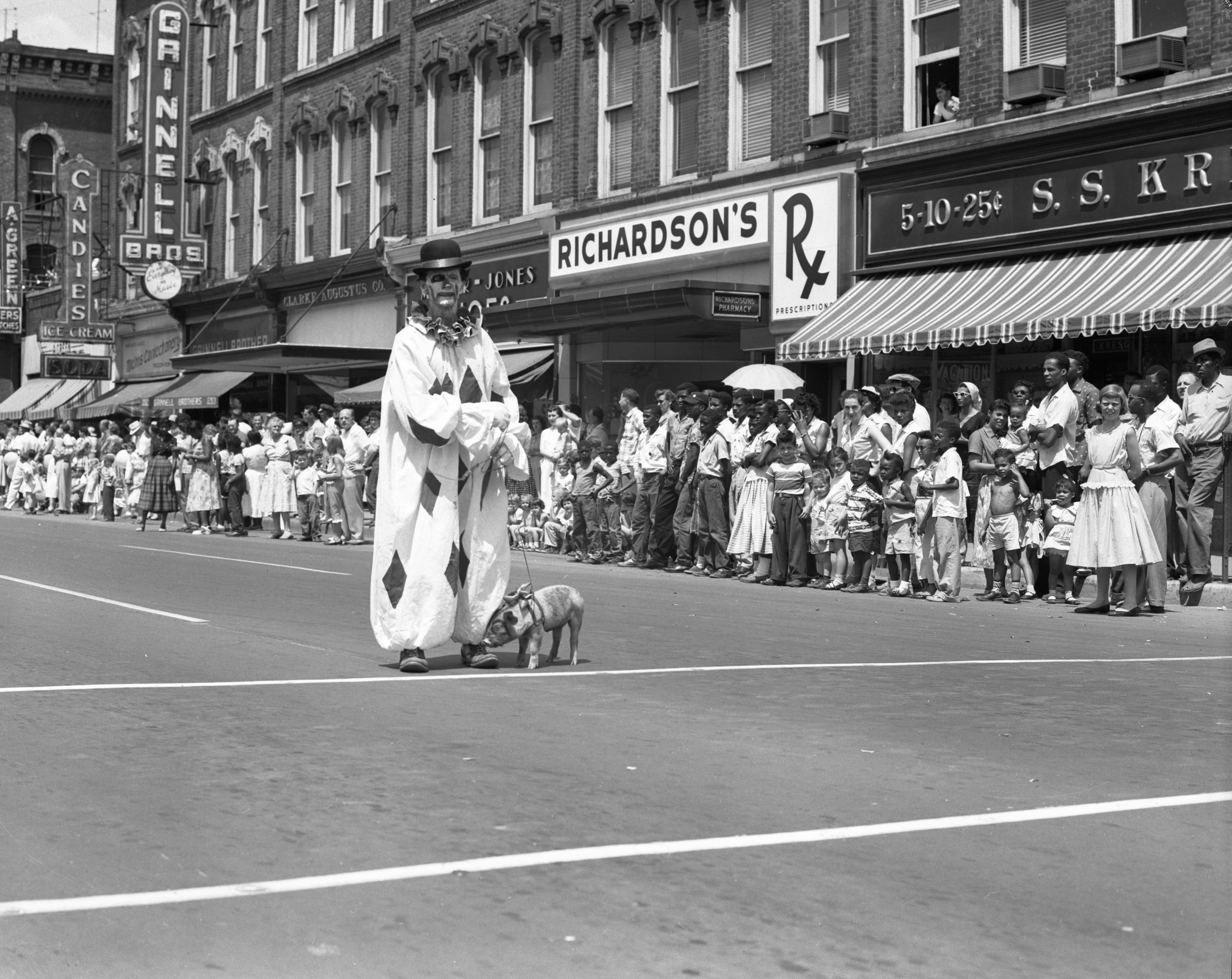 Clown Ben Moyer and Pet Pig March in Ypsilanti Fourth of July Parade, July 1955 image