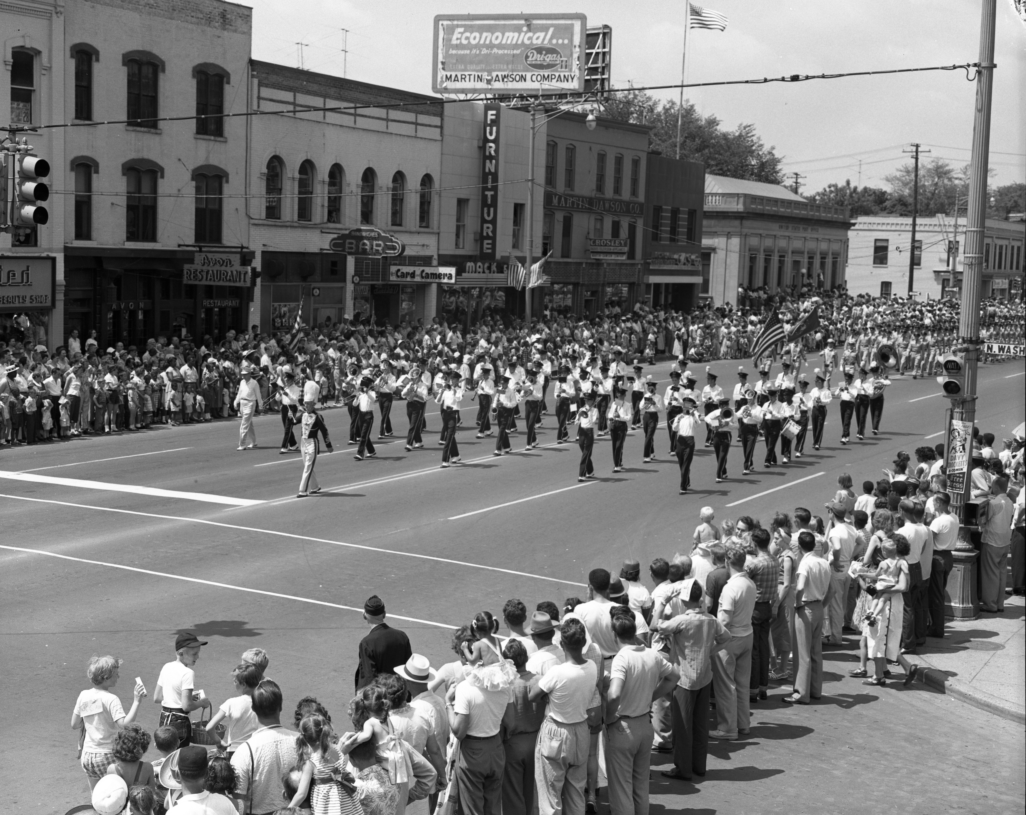 Ypsilanti High School Boy's Marching Band Entertain Record Crowd in Ypsilanti Fourth of July Parade, July 1955 image