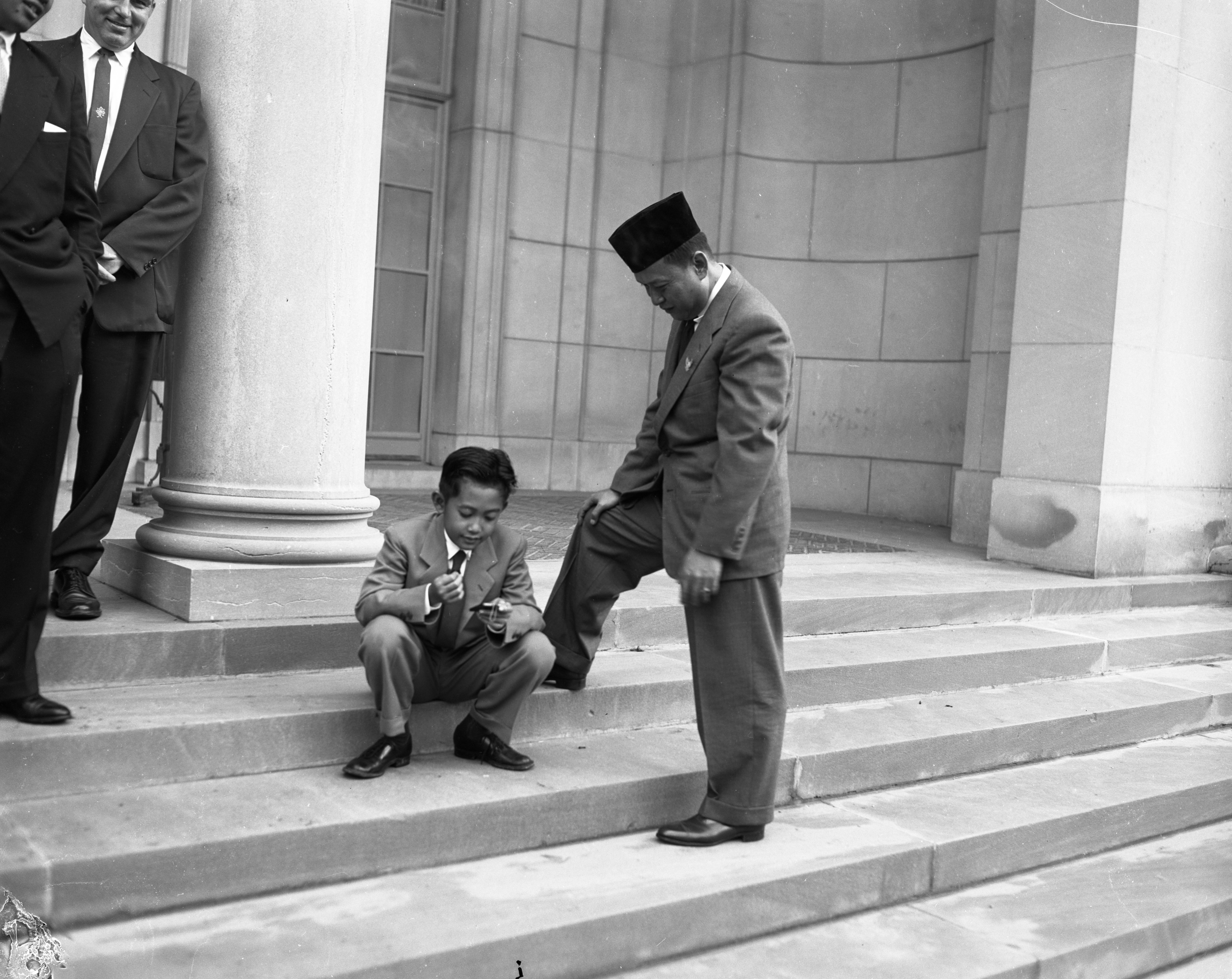 Mohammed Guntur, son of the President Sukarno of Indonesia, with his tutor Tukimin, on the steps of the Clements Library, May 1956 image