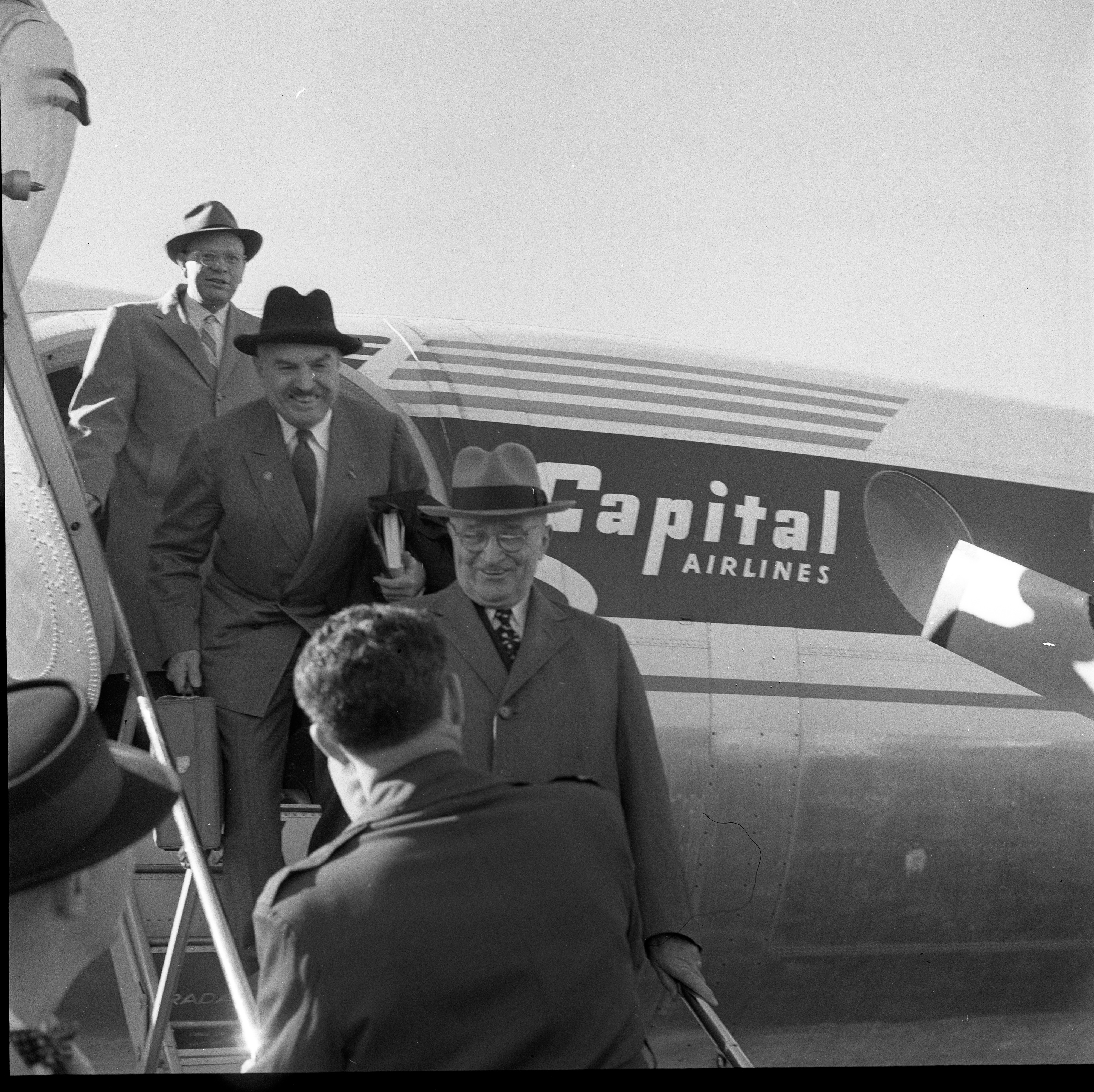 Harry Truman & Neil Staebler Exit Airplane At Willow Run Airport, October 1958 image