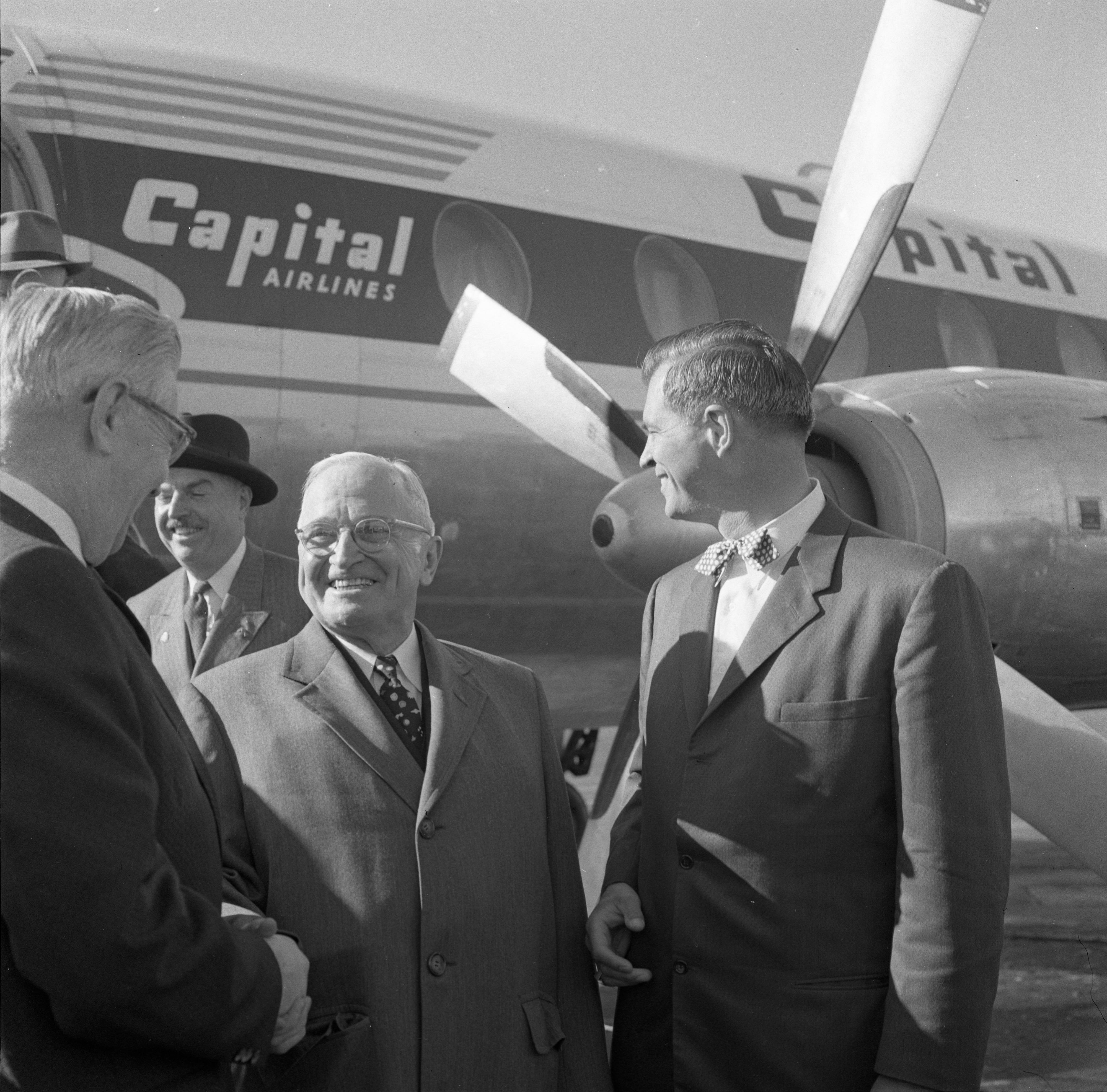 Harry Truman Is Greeted by Governor G. Mennon Williams & Others At Willow Run Airport, October 1958 image