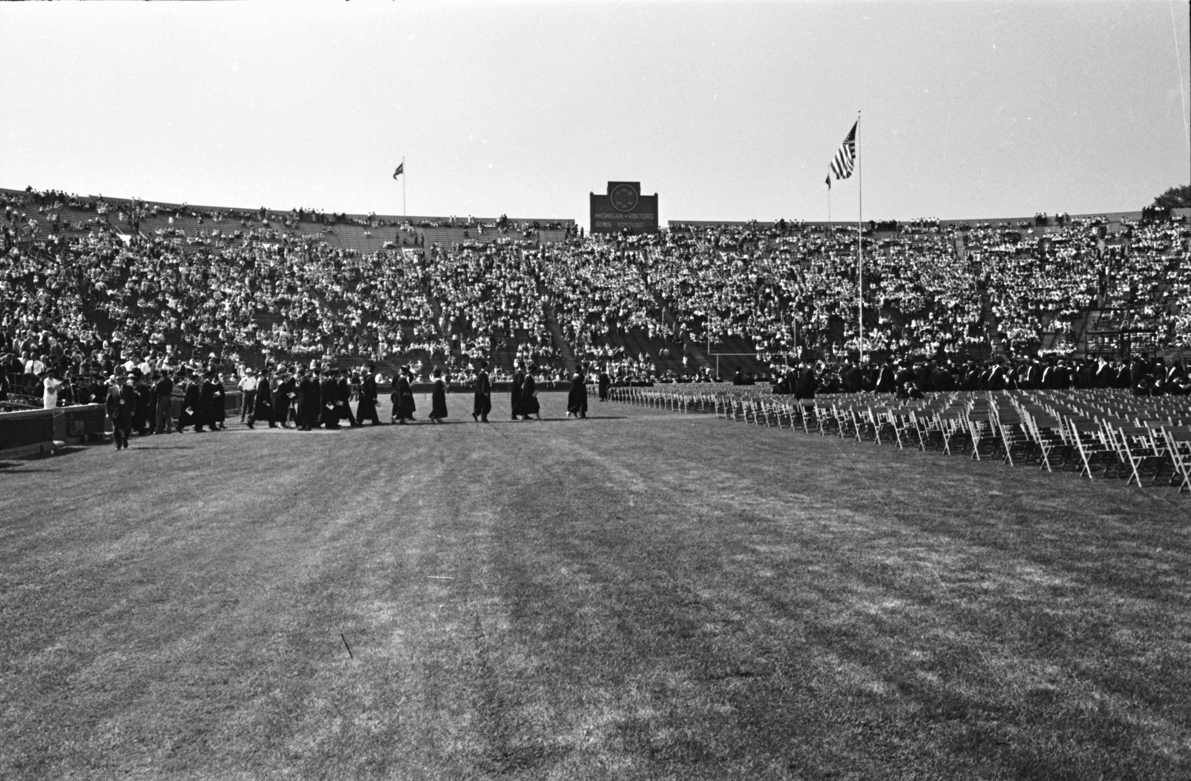 "Lyndron B. Johnson and others arriving on the field, U-M Commencement, May 22, 1964 (LBJ's ""Great Society"" Speech) image"