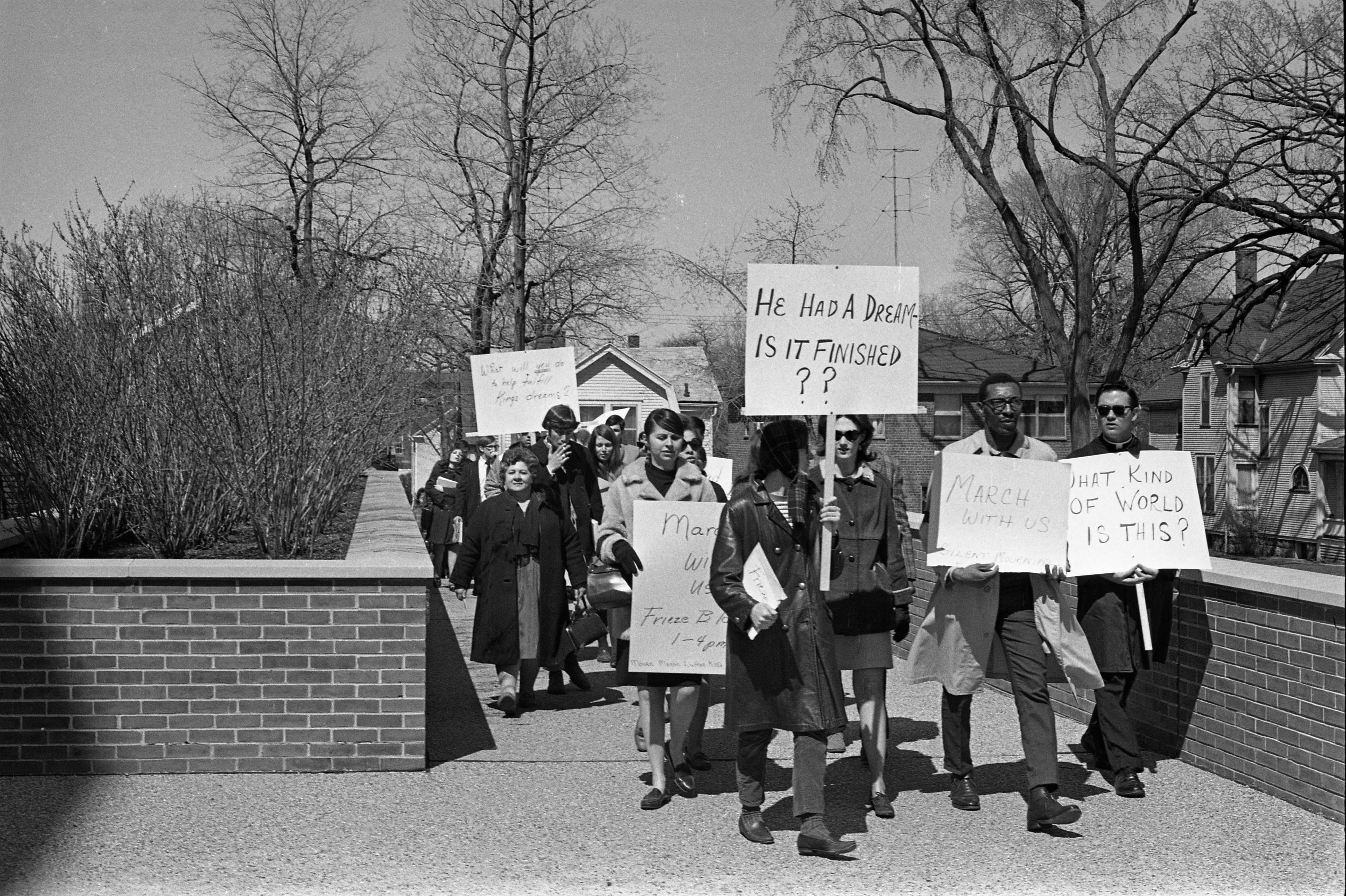 Marching On Huron Street With Signs After Martin Luther King Jr Memorial Services, April 1968 image