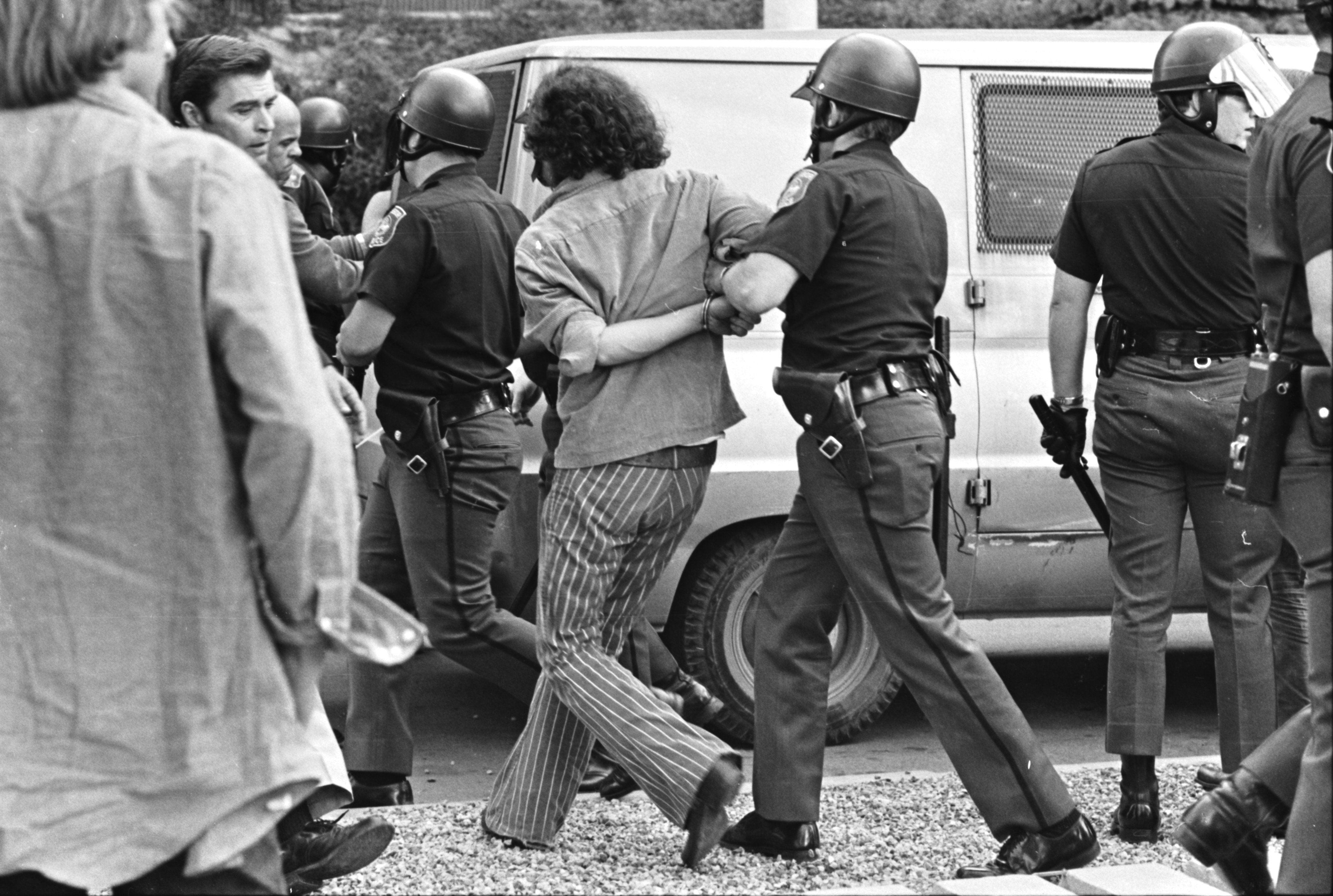 "Vietnam War Protesters Arrested For Digging ""Craters"" on U-M Campus Diag, June 1972 image"