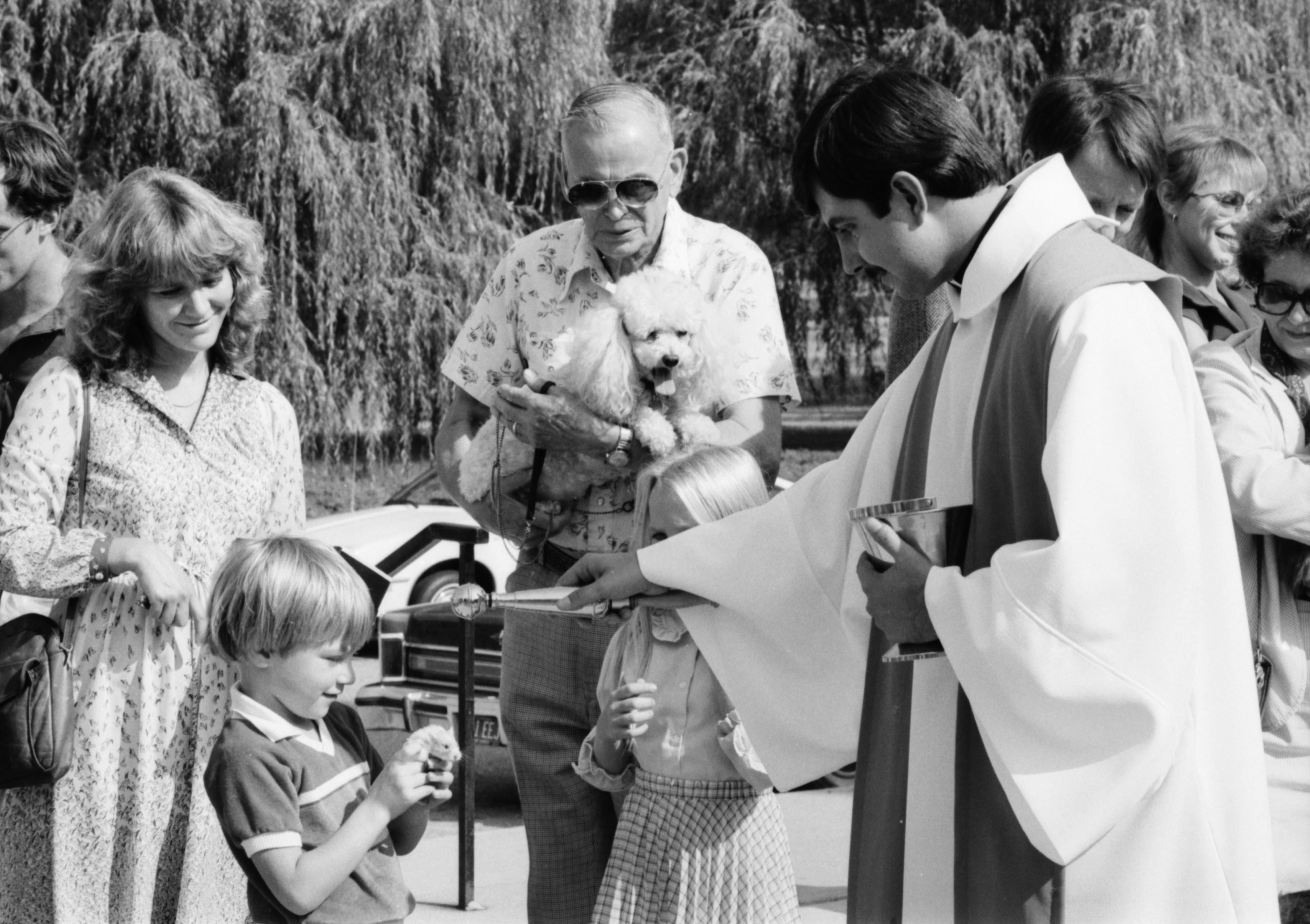 Rev. Mark Inglot blesses Neil Zajic's hamster, Bronco, during the Blessing of the Pets at St. Francis of Assisi Church, October 1983 image