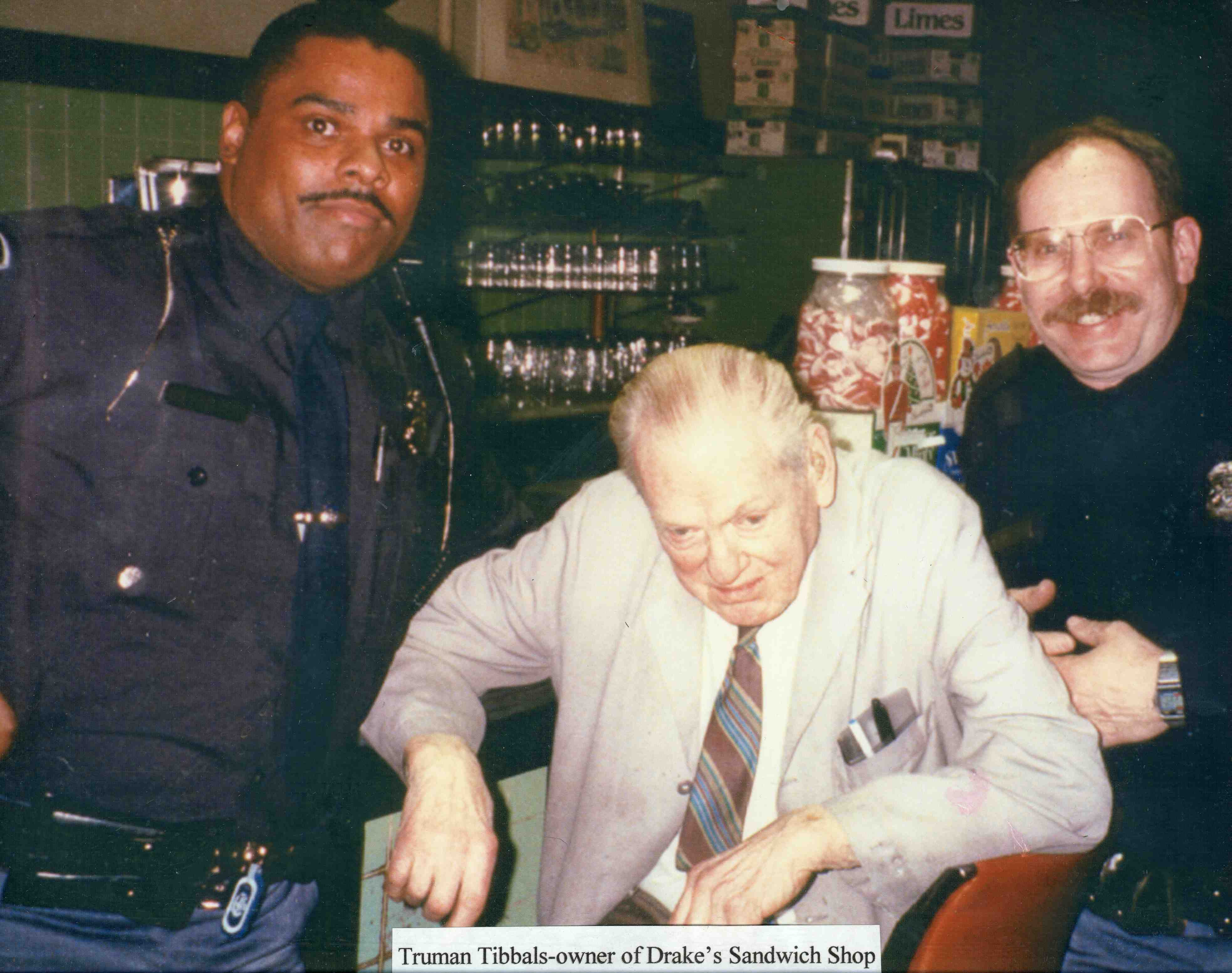 Truman Tibbals, Owner of Drake's Sandwich Shop with Ann Arbor Police Department officers image