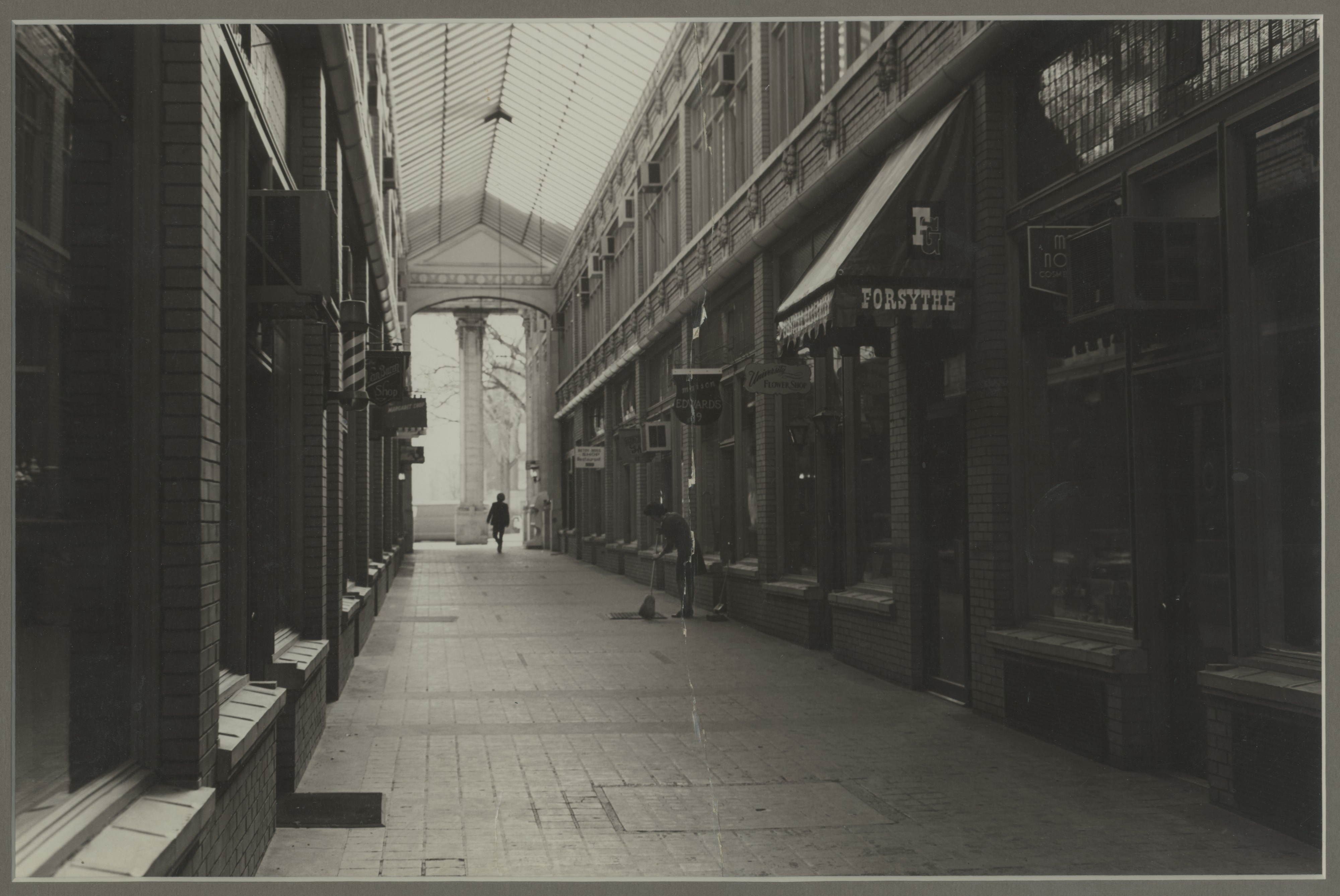 Maison Edwards Owner Augusta Edwards Sweeping Front of Store in Nickels Arcade, 1969 image