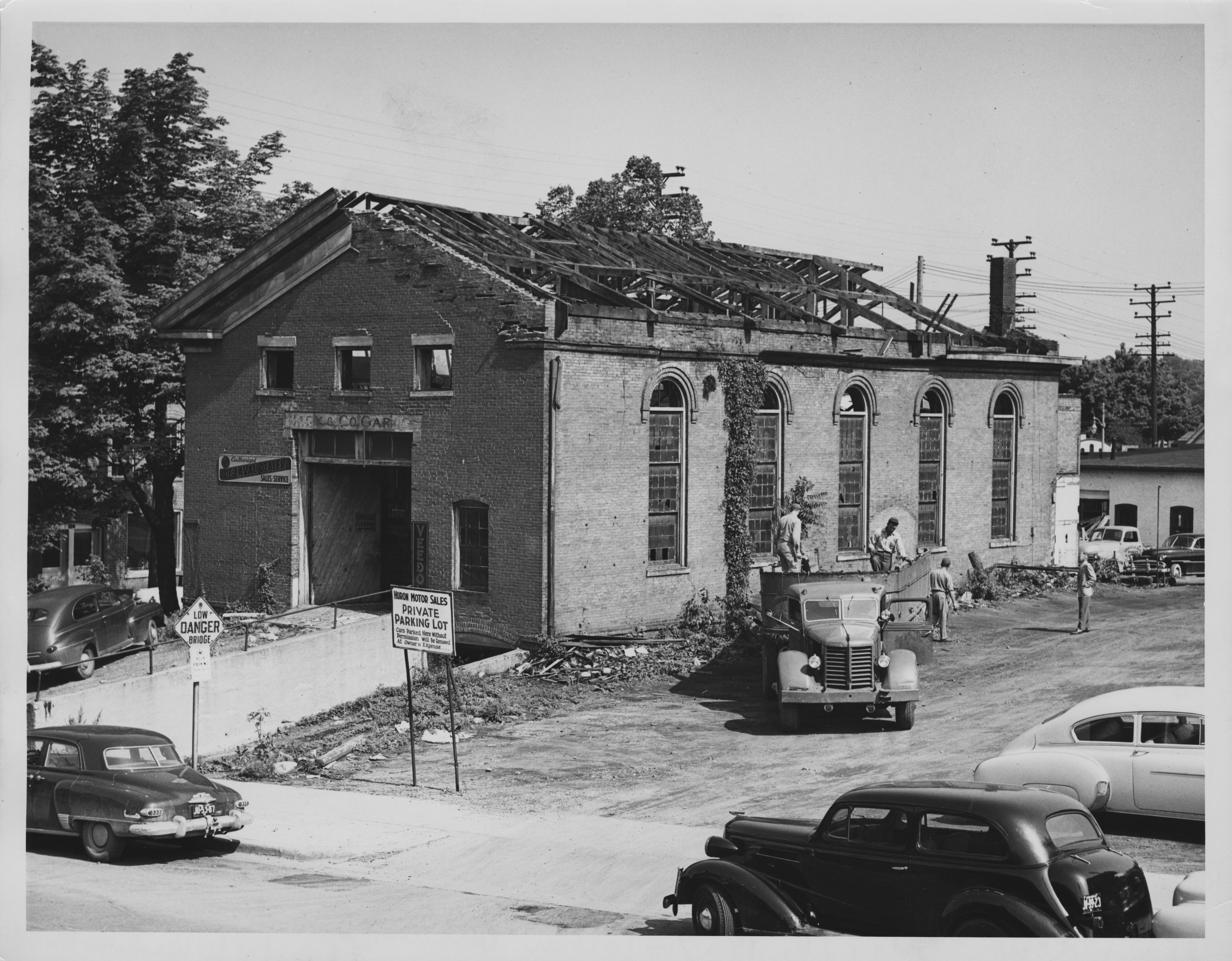 Old Bethlehem Church at S. First and W. Washington St, owned by Huron Motor Sales, getting torn down on June 16, 1951 image