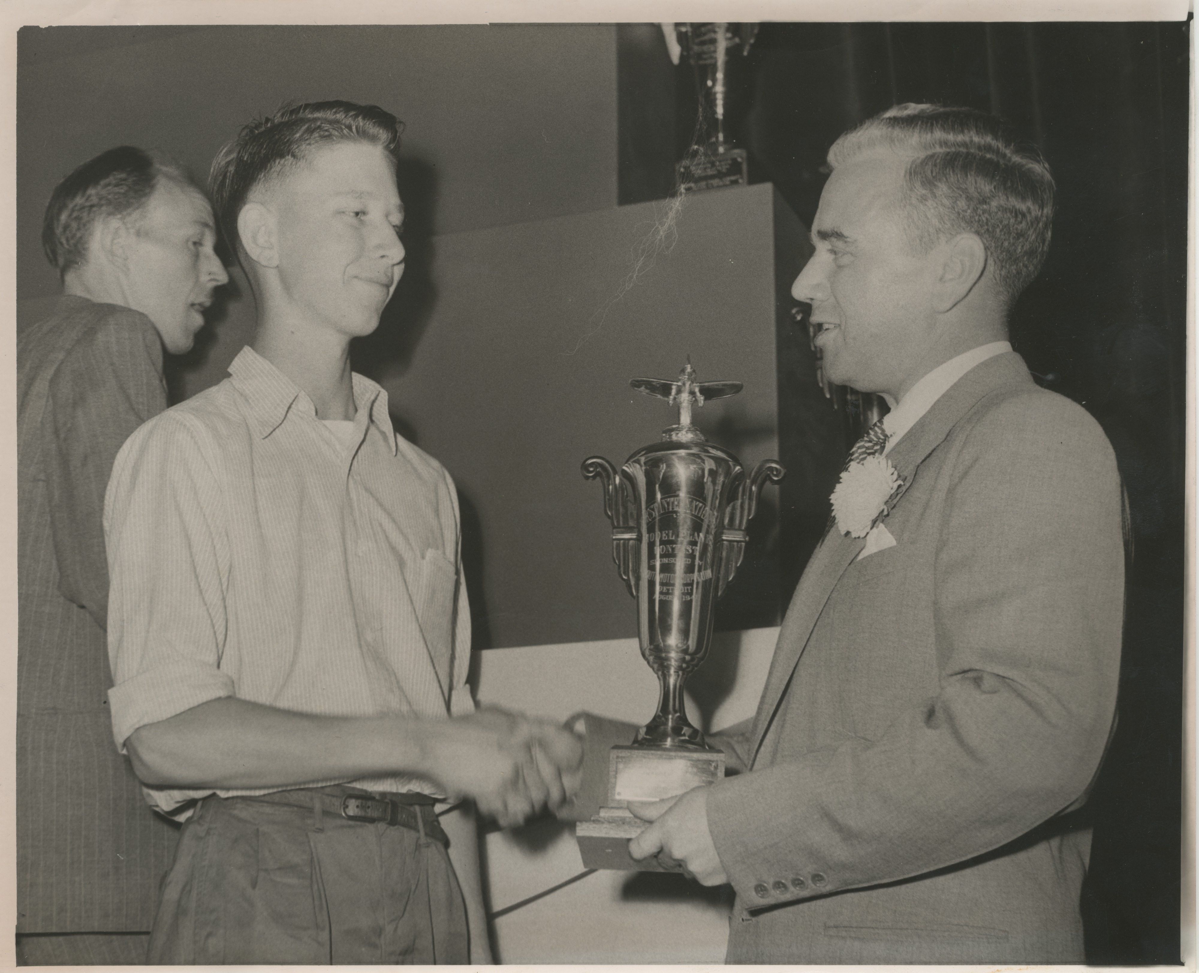 Erwin Paul Wallaker Accepting Trophy at Model Plane Contest, 1947 image