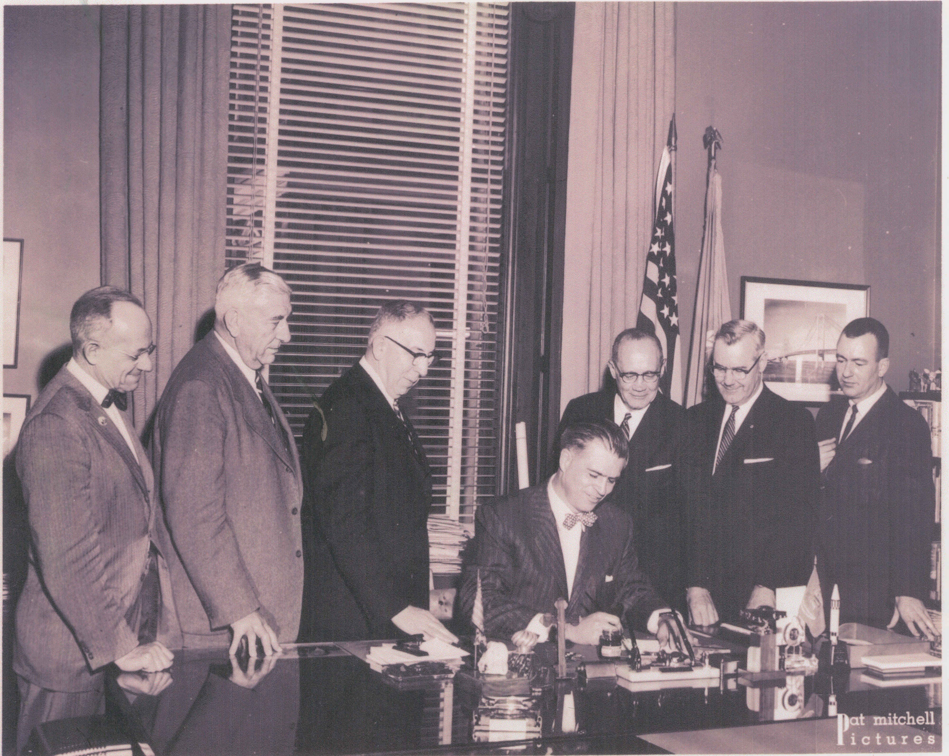 Gov. G. Mennen Williams Signs Bill Changing Eastern Michigan College to Eastern Michigan University, 1959 image