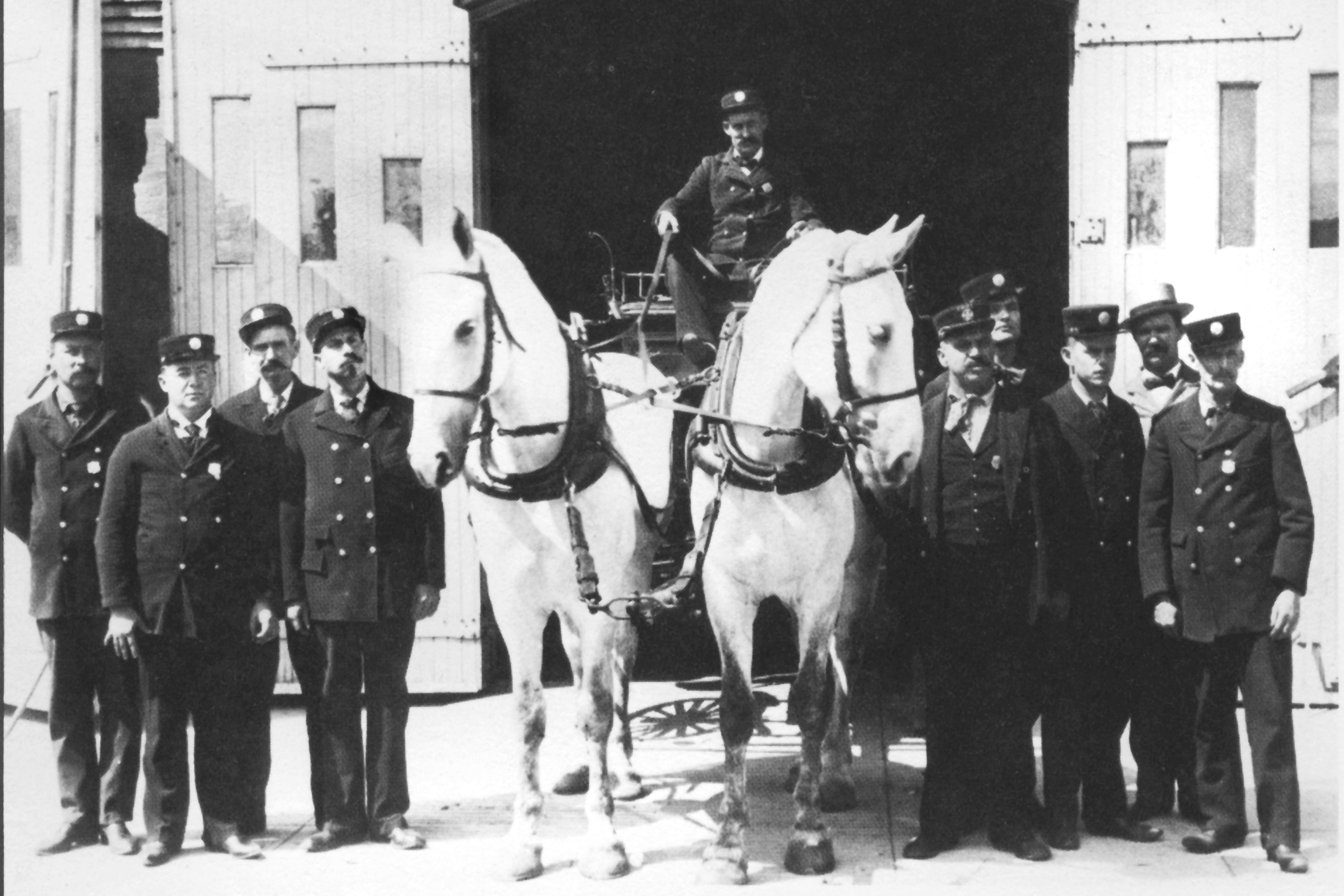 Firefighters at Firemen's Hall, East Huron Street, 1906 image