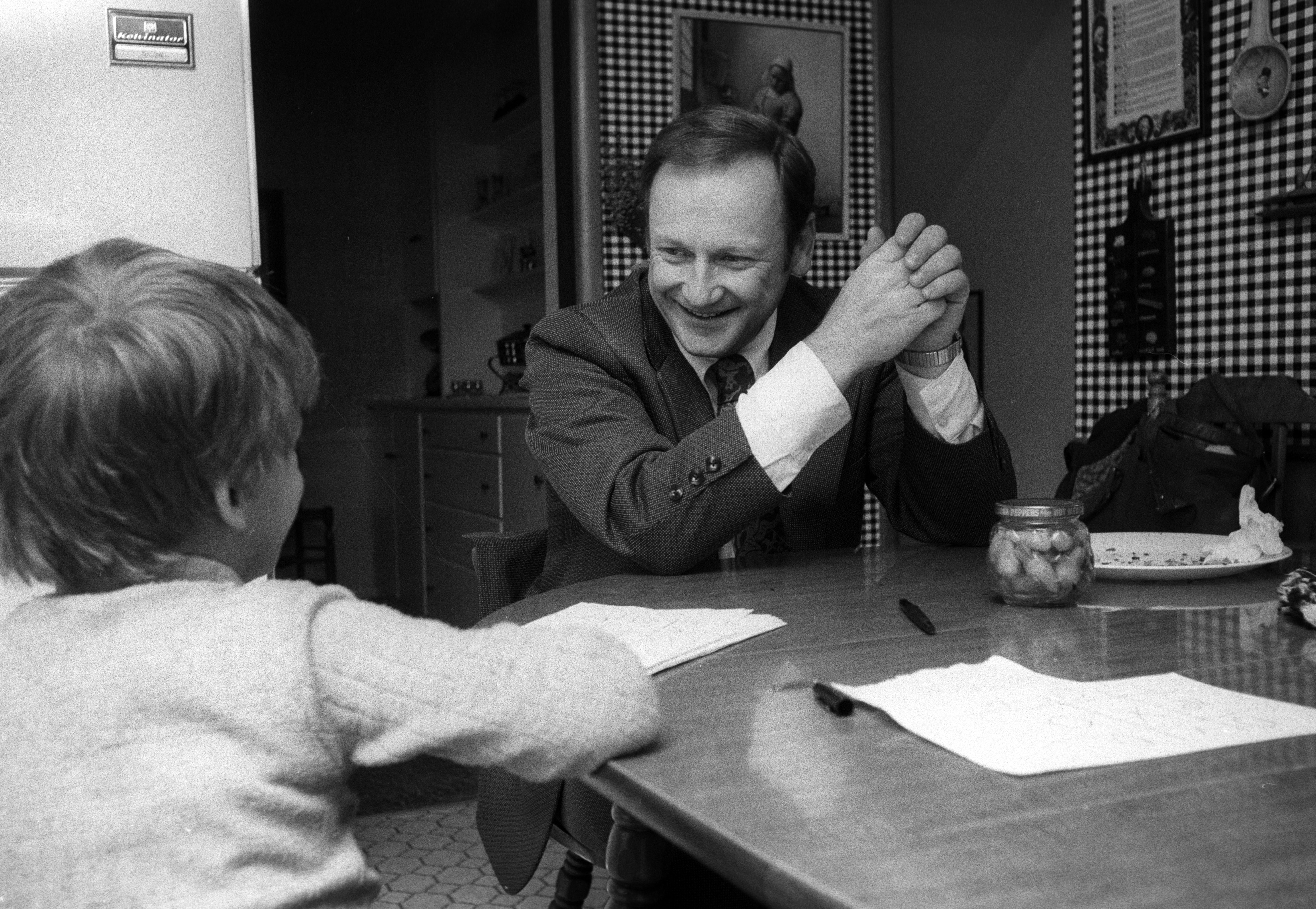 Michigan Coach Bo Schembechler At Home For Lunch with Son Shemy, 1977 image