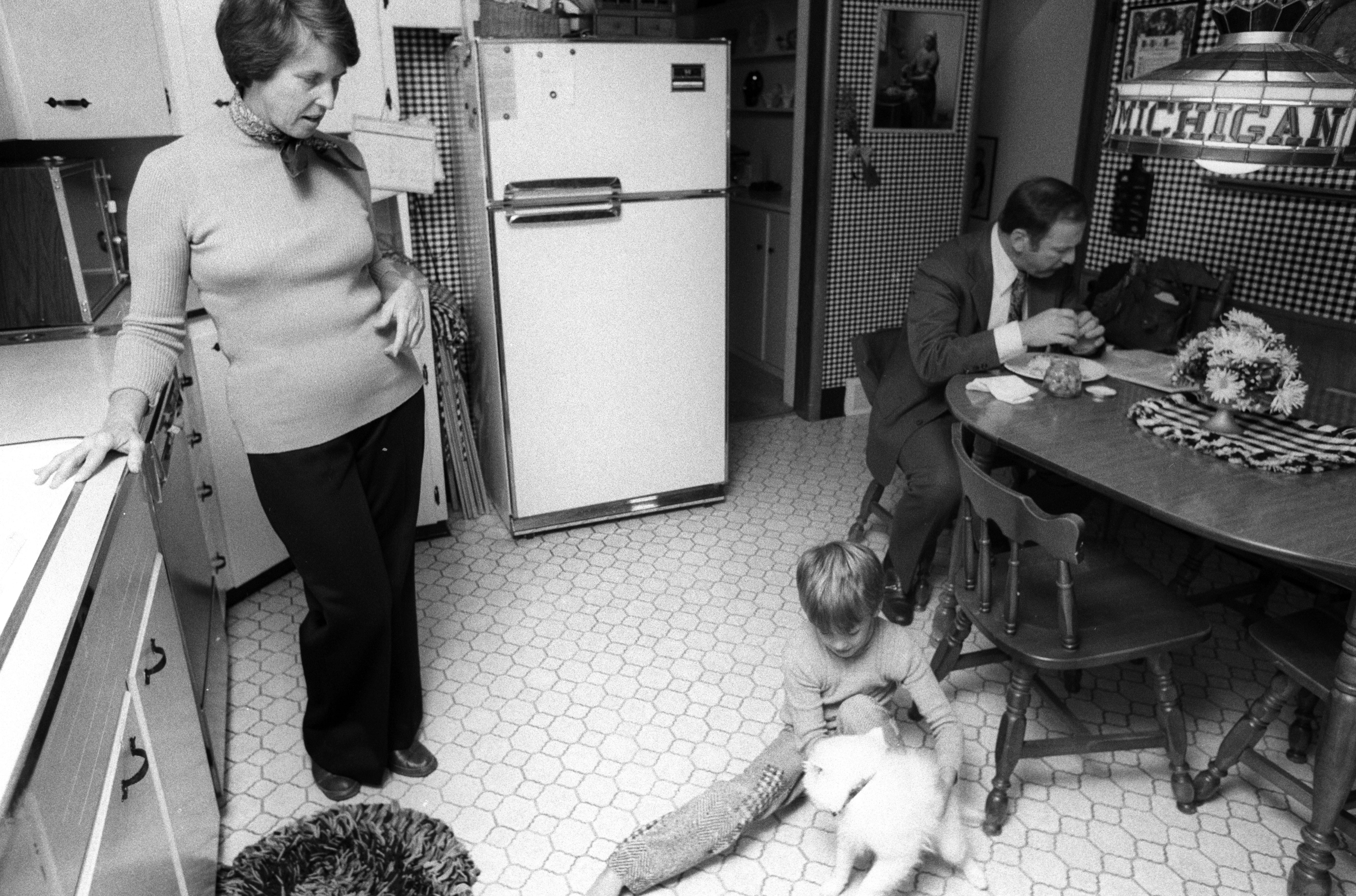 Michigan Coach Bo Schembechler At Home For Lunch with Son Shemy and Wife Millie, 1977 image