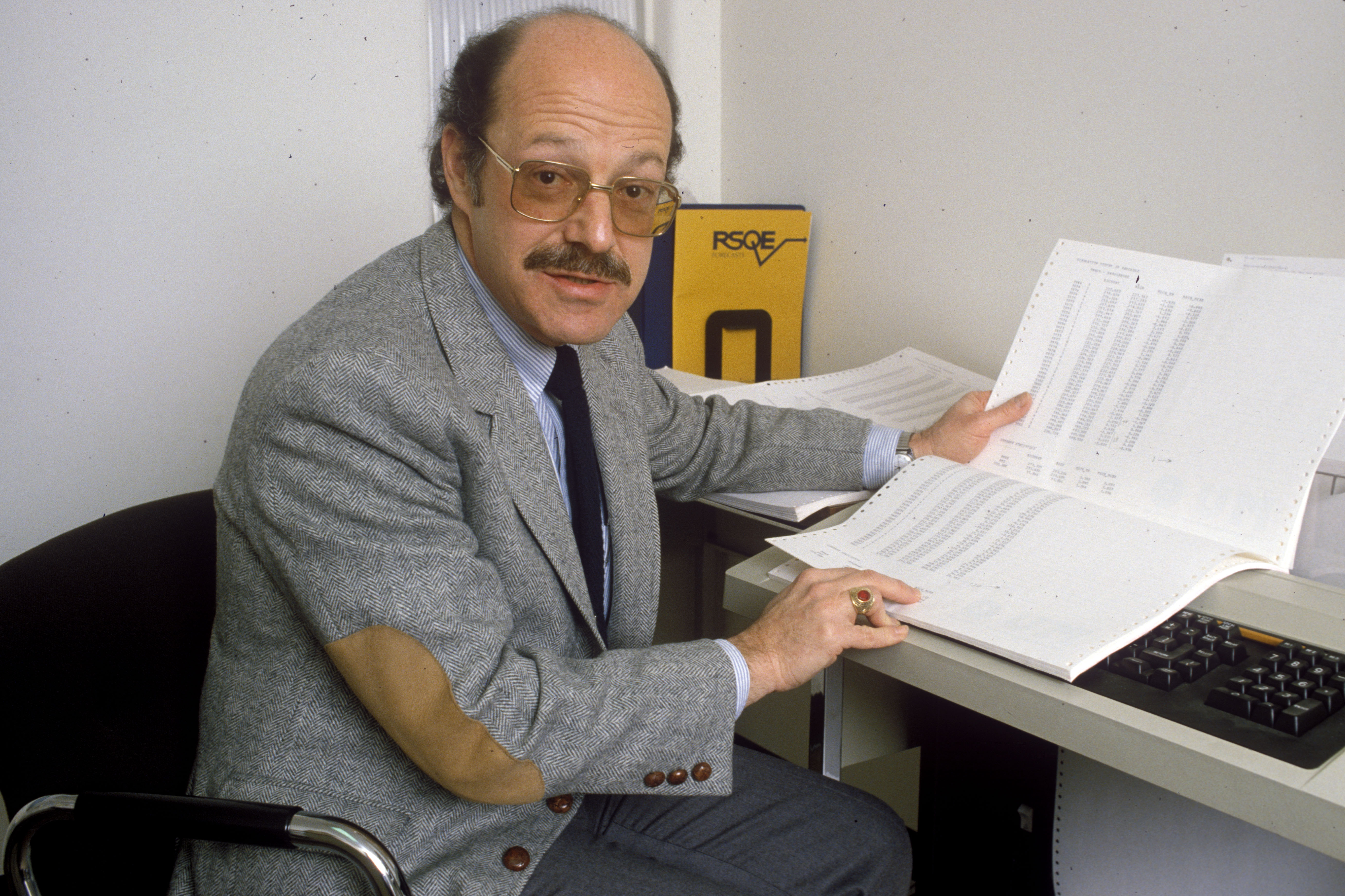 Saul H. Hymans, Professor of Economics and Director of the Research Seminar in Quantitative Economics at the University of Michigan in Ann Arbor, December 1983 image