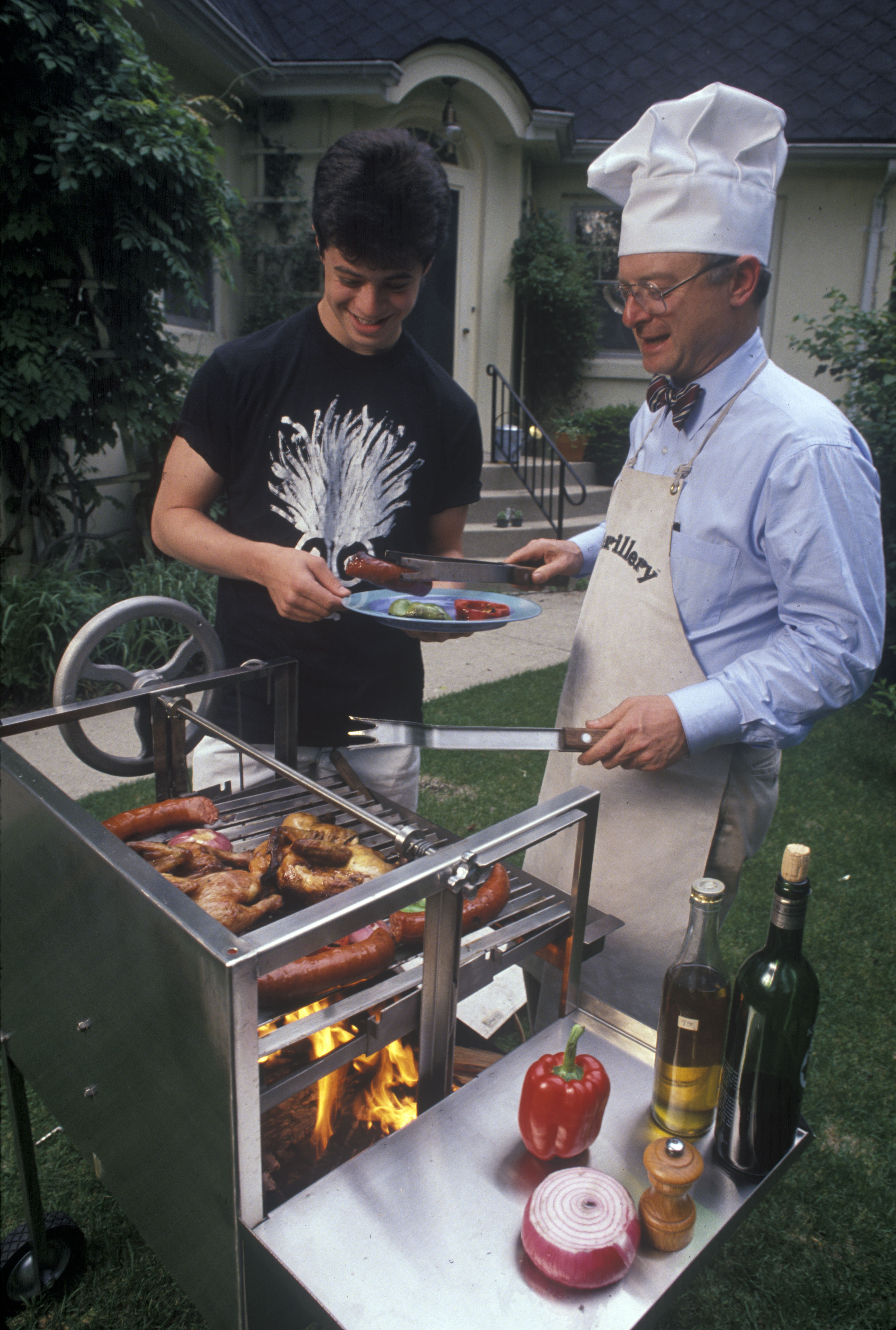 "Charles R. Eisendrath Cooking on ""The Grillery,"" a Product of His Company Grillworks, Inc., May 1990 image"