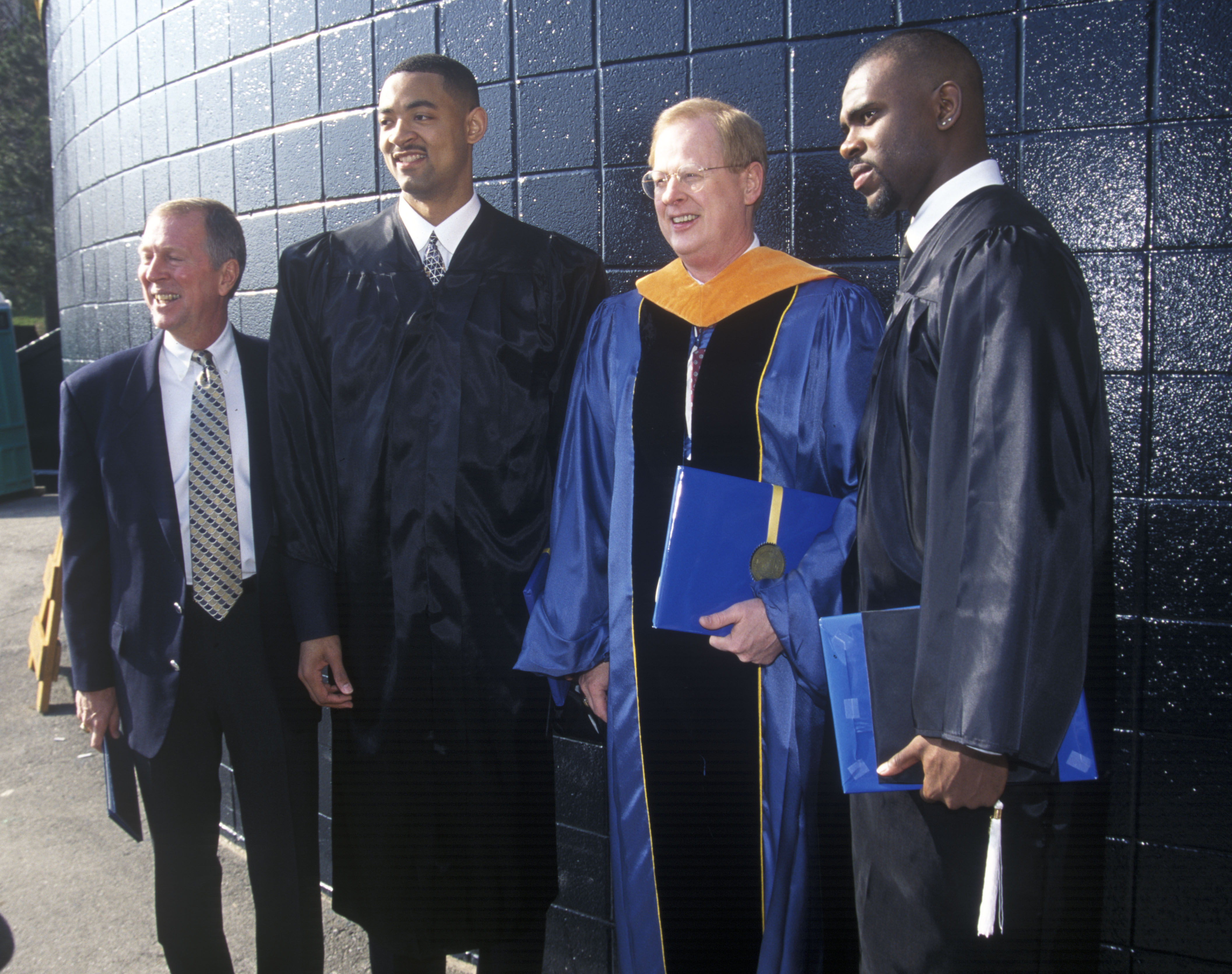 U-M Basketball Coach Steve Fisher, Basketball Player Juwan Howard, U-M President James J. Duderstadt, and Ray Jackson at Michigan Commencement, April 1995 image