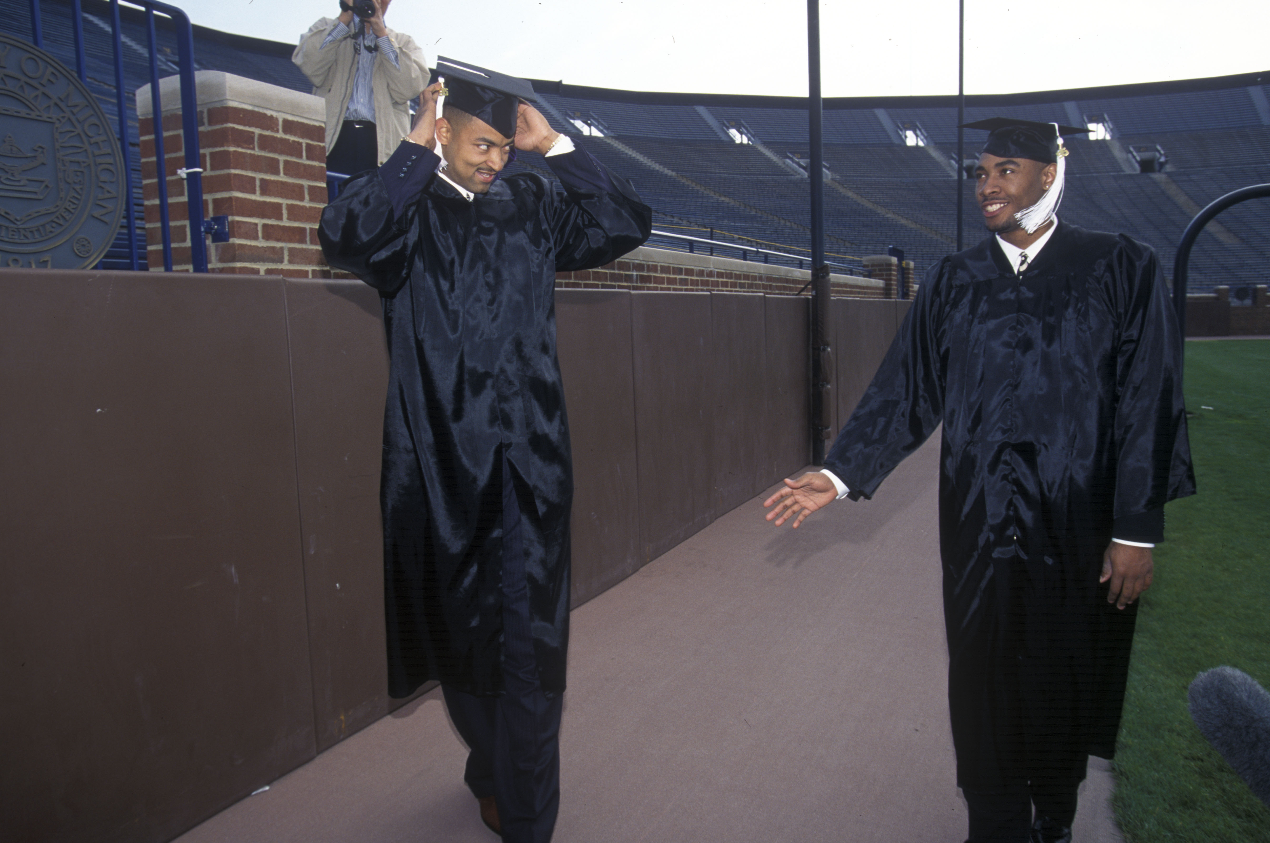 U-M Basketball Player Juwan Howard, left, at Michigan Commencement, April 1995 image