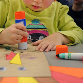 Child using gluestick for crafts