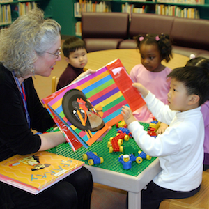 Librarian reading story to child