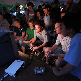 Teens and adults playing console games